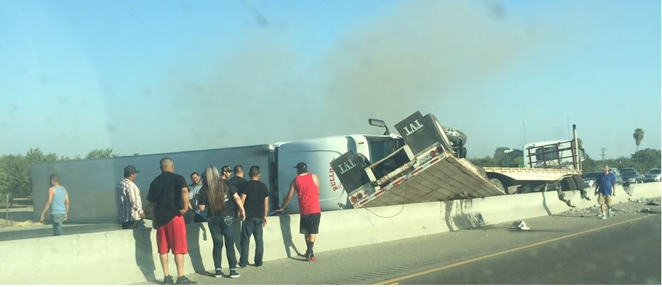 A big rig crash on southbound Highway 99 causes massive traffic delays on Sunday morning, Aug. 6, 2017, in McFarland, Calif. Photo provided by Denise Barba.