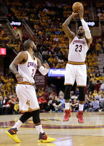 Cleveland Cavaliers forward LeBron James (23) puts up a 3-point shot as guard Kyrie Irving (2) looks on in the second half against the Atlanta Hawks during Game 2 of a second-round NBA basketball playoff series, Wednesday, May 4, 2016, in Cleveland. (AP Photo/Tony Dejak)