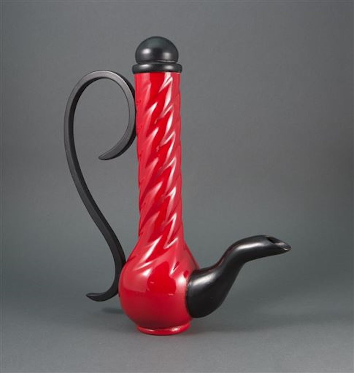 Work by Nancy Bowman, a 16-year woodturning veteran / The body was turned and hollowed on lathe, while the handle and spout were carved. The twist on body of tea pot is laid out on the lathe using an index wheel and then hand-carved off lathe, and lacquered in red and black / Image: Nancy Bowman{ }// Published: 4.18.19
