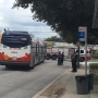Woman pulled under bus as she tried to board
