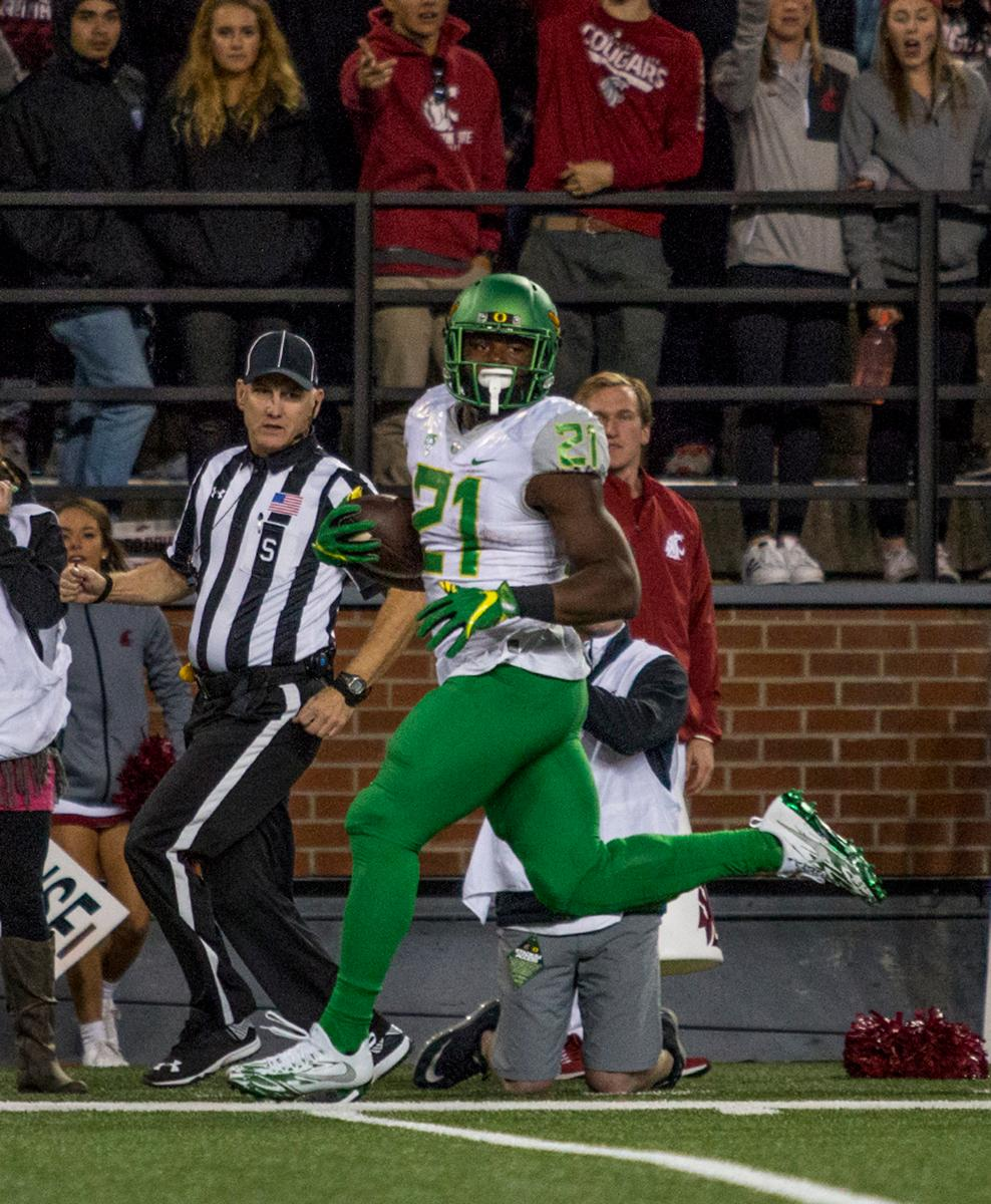 Oregon Ducks Royce Freeman (#21) rushes down the field. The Cougars beat the Ducks 51-33 at Martin Stadium on Saturday evening. Photo by Katie Pietzold