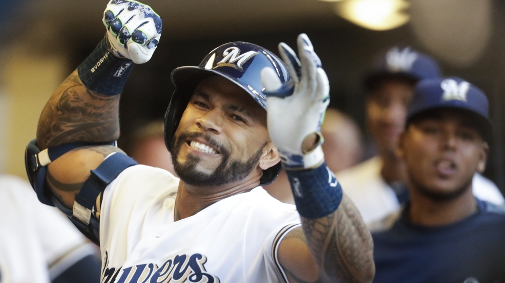 Milwaukee Brewers Eric Thames celebrates after hitting a home run during the first inning of a baseball game against the San Diego Padres Wednesday, Aug. 8, 2018, in Milwaukee.