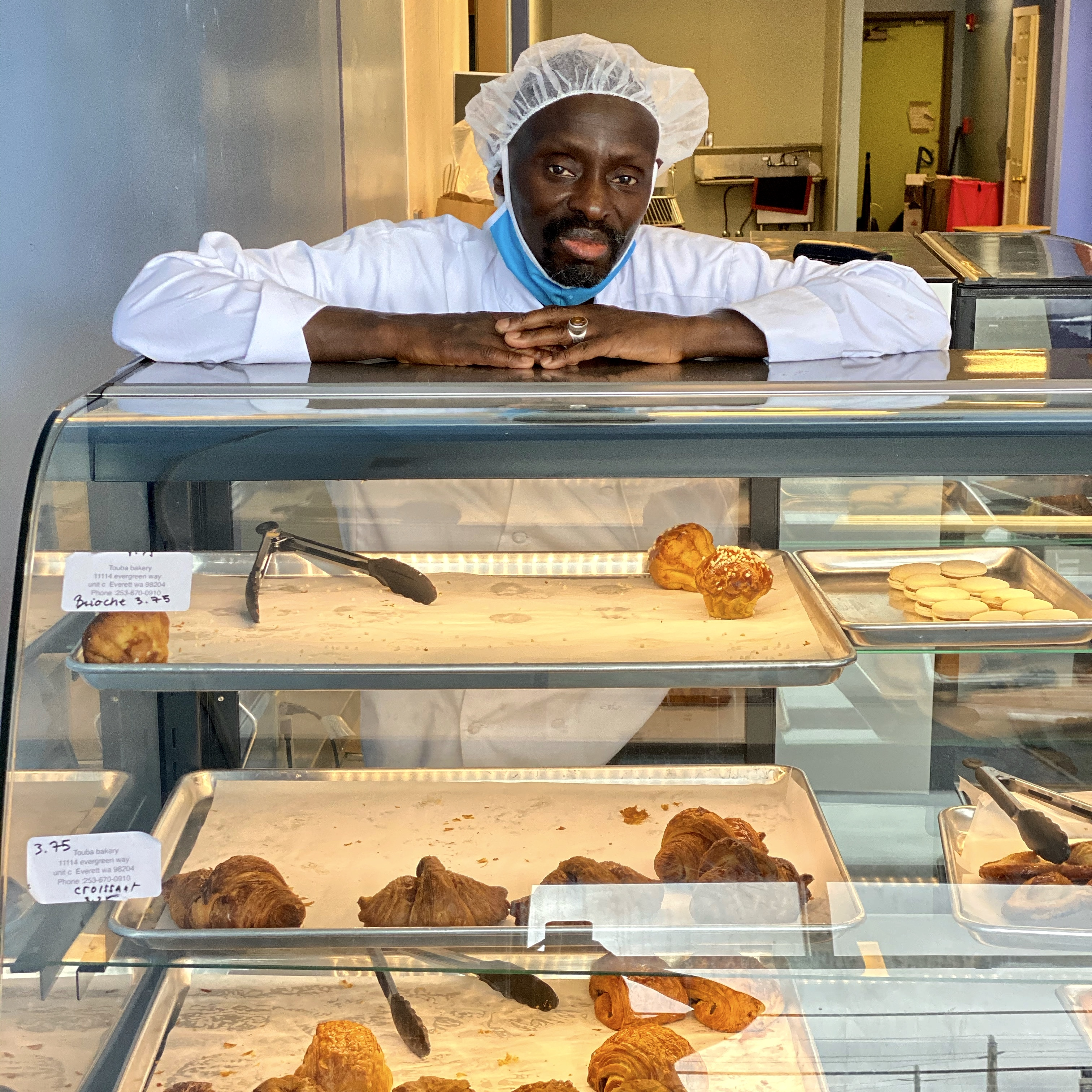 Papa Seck, owner of Touba Bakery in Everett - a business in the Intentionalist database.{ } (Image: Intentionalist)