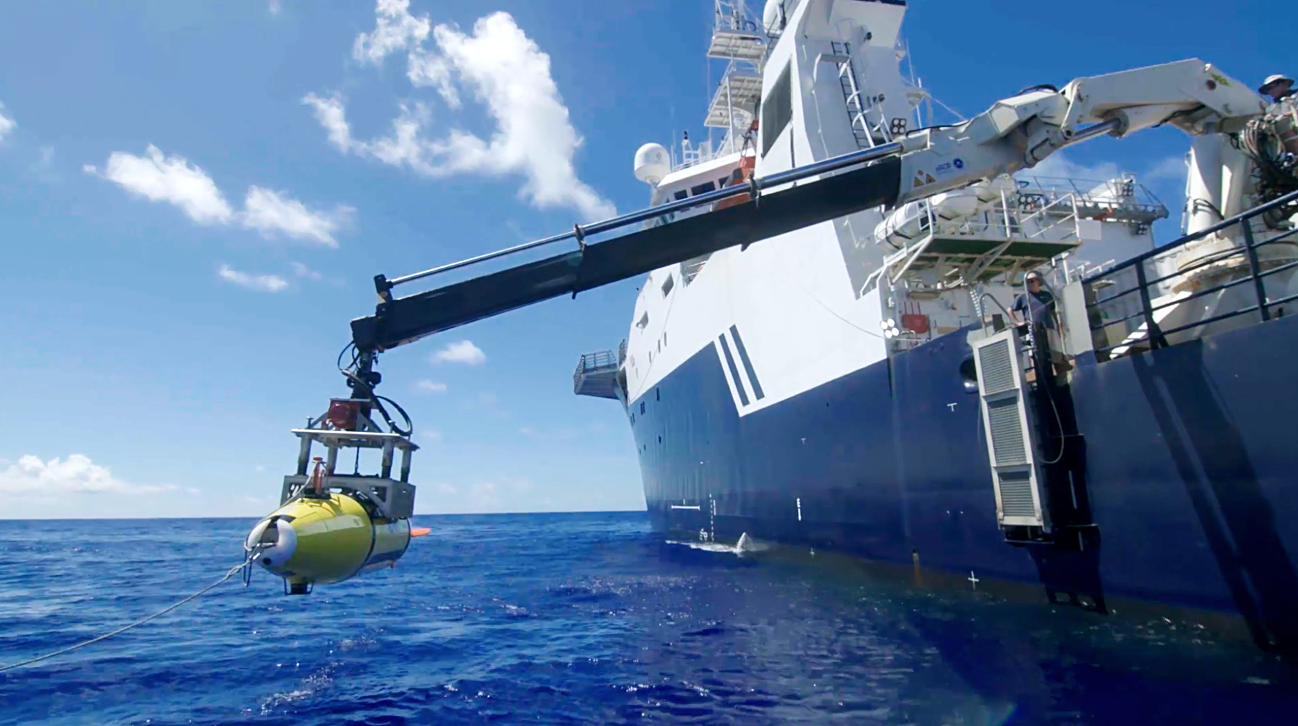 The AUV is lowered into the Philippine Sea in search of the USS Indianapolis. Photo courtesy of Paul G. Allen.