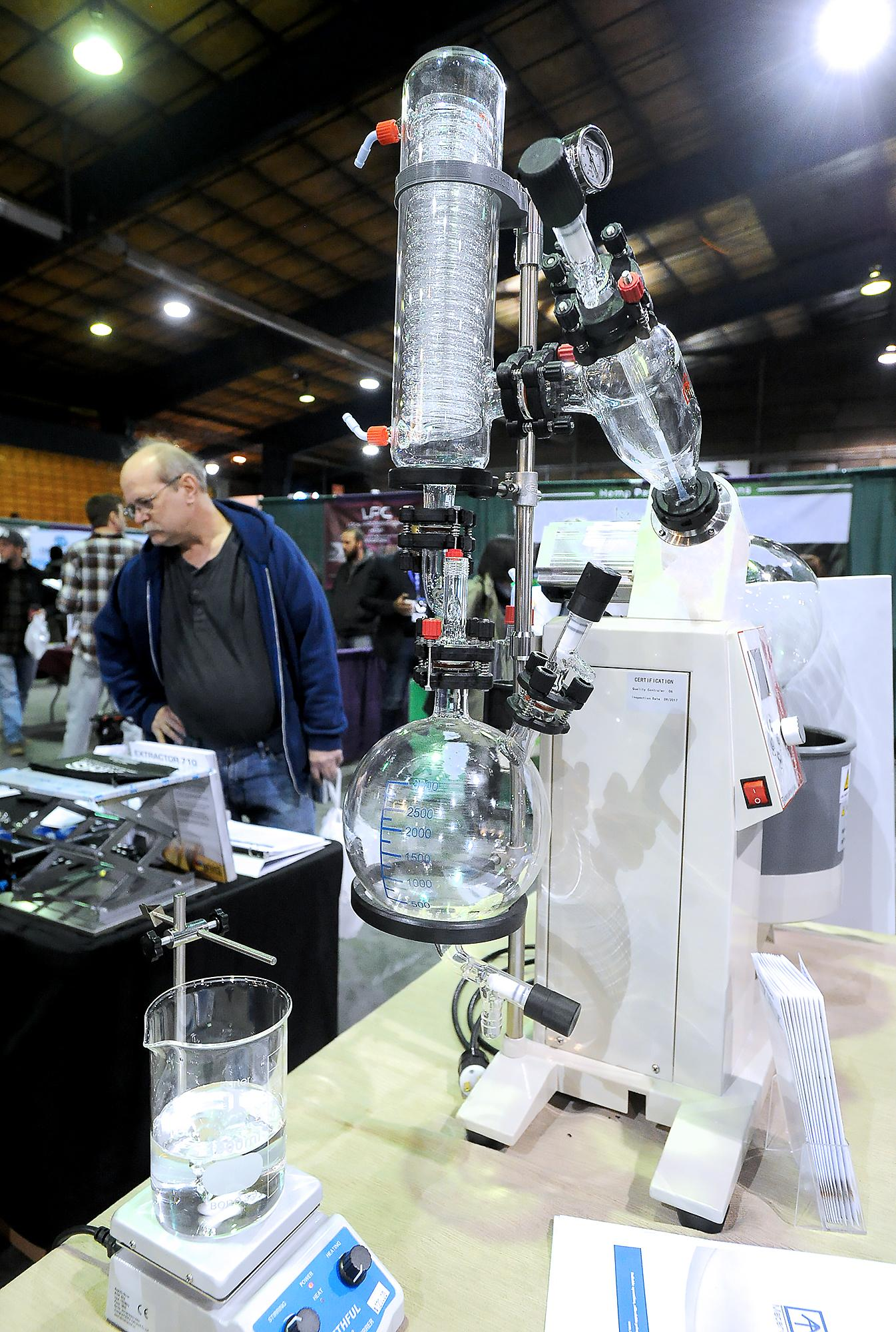 A rotary evaporator for distilling THC and CBD  from cannabis is on display at this year's THC Fair in Central Point. Photo by Denise Baratta