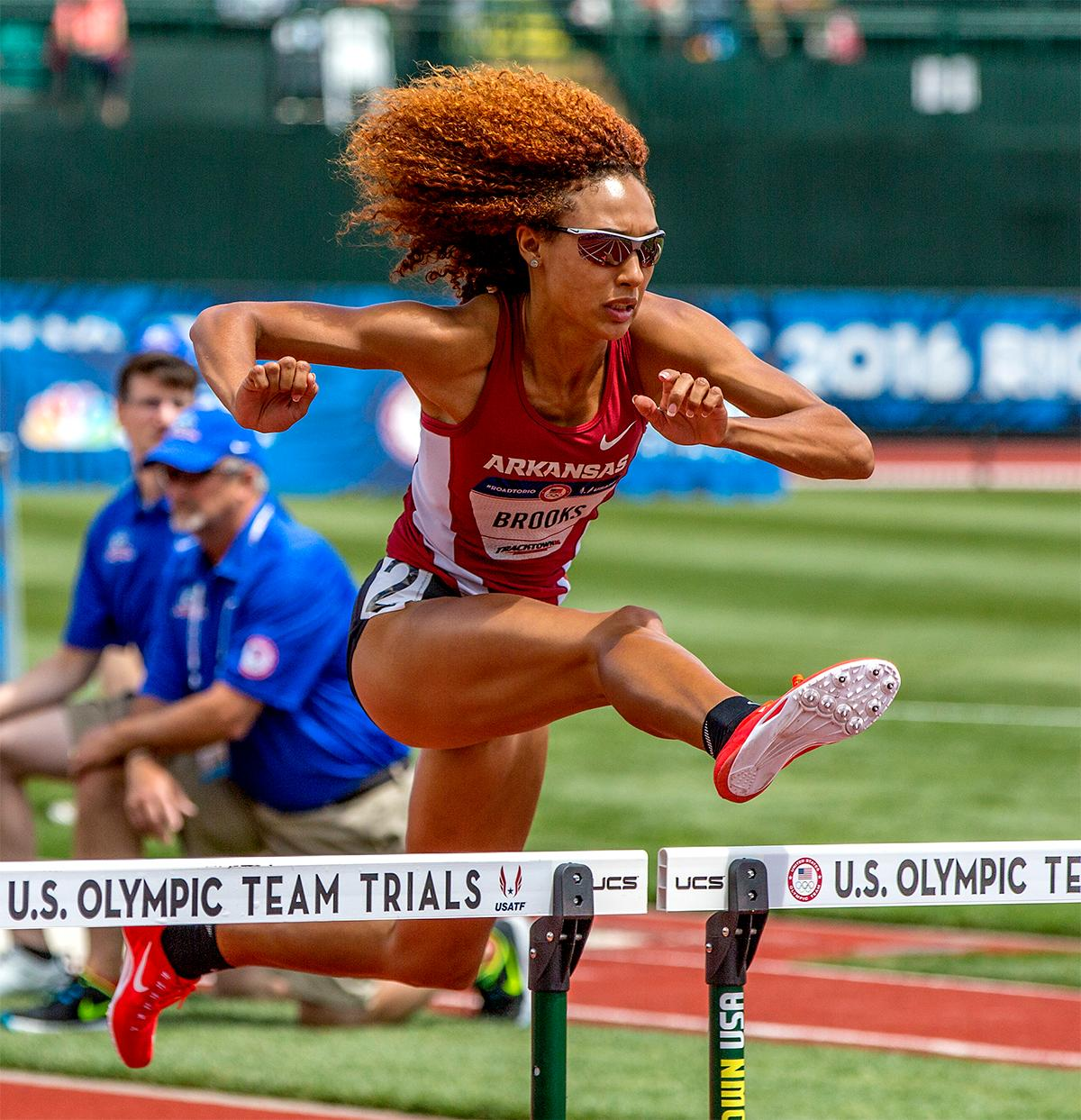 Taliyah Brooks springs over hurdles as her hair fans out behind her in the 100 meter hurdles portion of the heptathlon. Brooks finished fourth in the hurdles with a time of 13.39. Photo by August Frank, Oregon News Lab