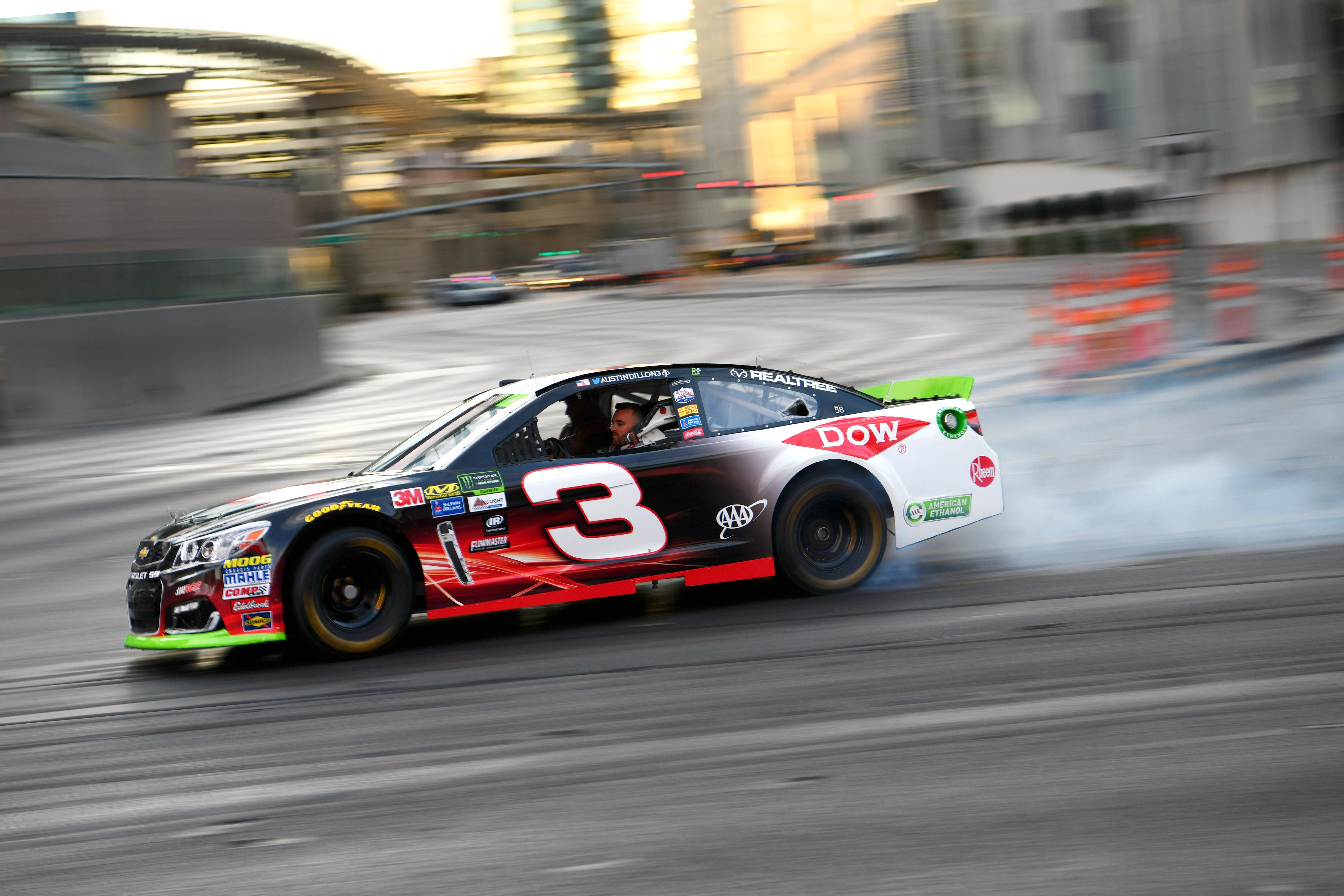 Austin Dillon does a burnout at the intersection of the Strip and Harmon Avenue during the NASCAR Victory Lap being held as part of Champions Week Wednesday, November 29, 2017. CREDIT: Sam Morris/Las Vegas News Bureau