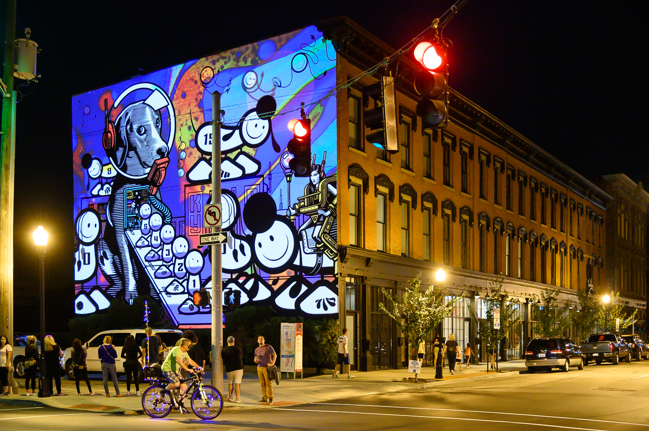 PICTURED NEIGHBORHOOD: Covington / The London Police mural on the side of Boone Block in Covington is one of the highlights of the neighbor's BLINK installations. / Image: Phil Armstrong // Published: 10.12.19