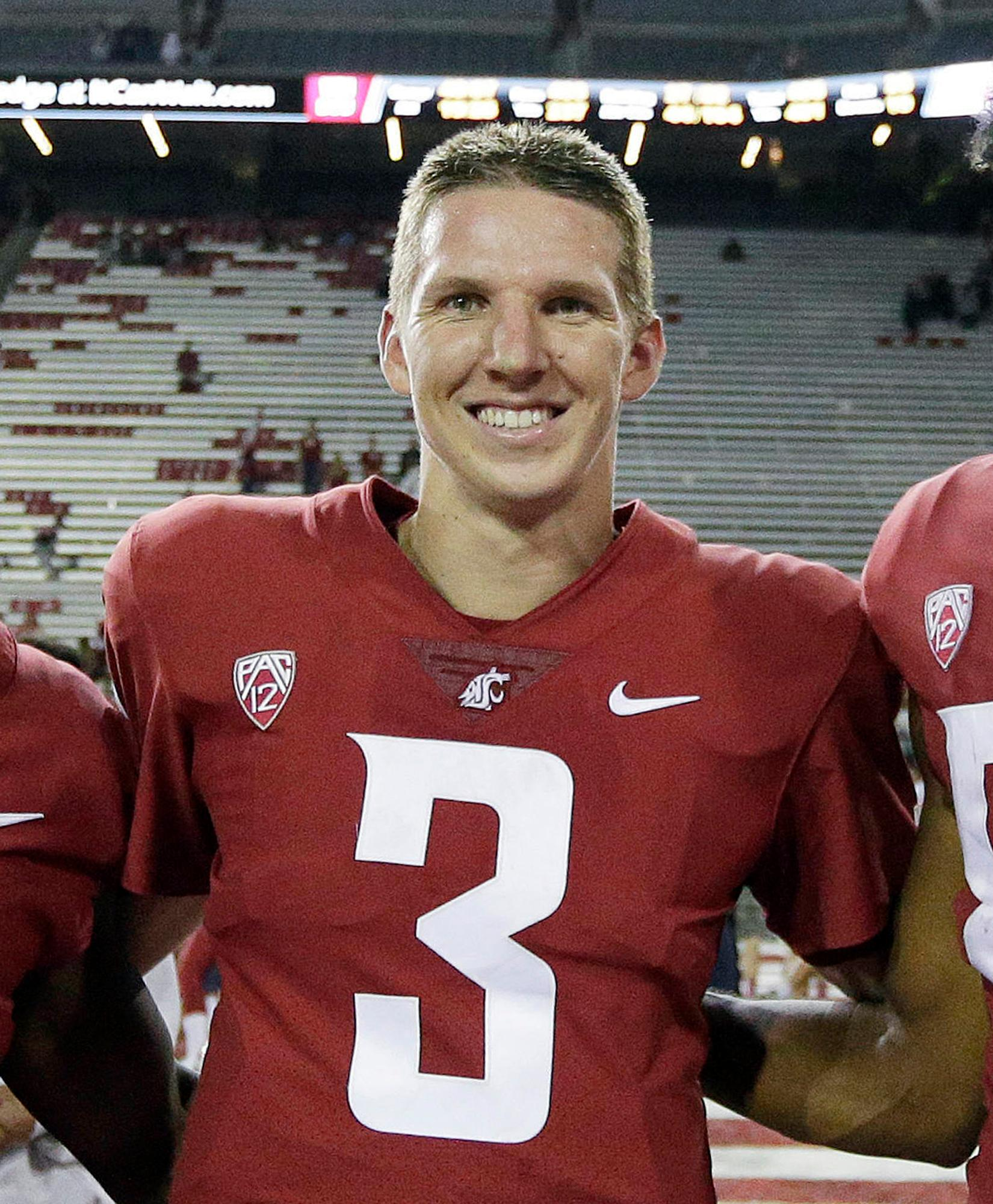 FILE - In this Sept. 9, 2017, file photo, Washington State quarterback Tyler Hilinski poses for a photo after an NCAA college football game against Boise State in Pullman, Wash. Hilinski has died from an apparent self-inflicted gunshot wound. The 21-year-old Hilinski was discovered in his apartment after he didn't show up for practice Tuesday, Jan. 16, 2018. (AP Photo/Young Kwak, File)