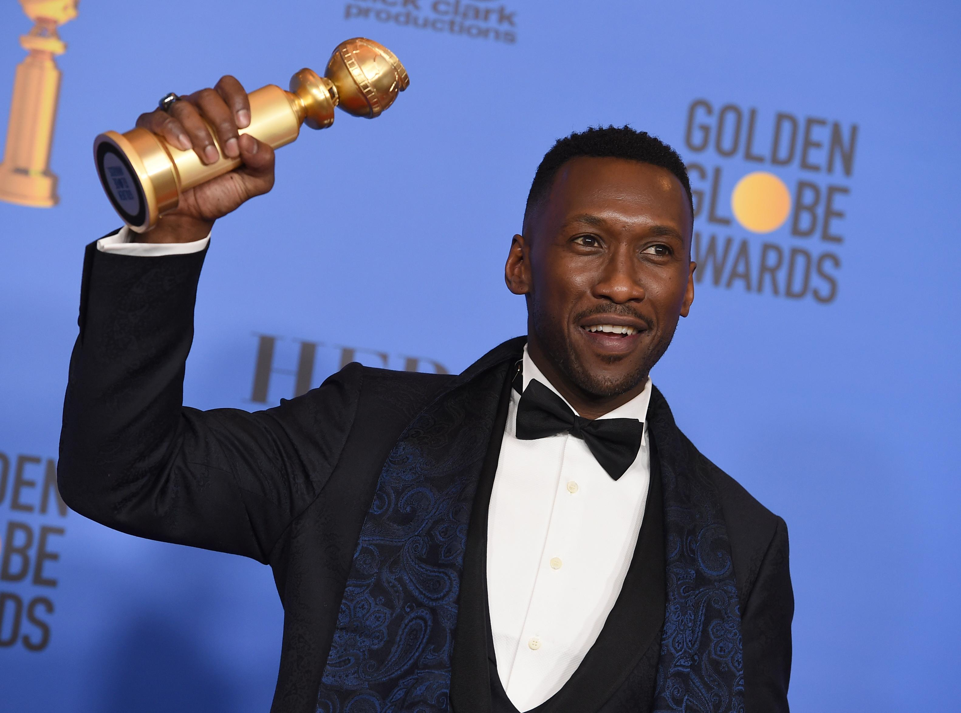"Mahershala Ali poses in the press room with the award for best performance by an actor in a supporting role in any motion picture for ""Green Book"" at the 76th annual Golden Globe Awards at the Beverly Hilton Hotel on Sunday, Jan. 6, 2019, in Beverly Hills, Calif. (Photo by Jordan Strauss/Invision/AP)"
