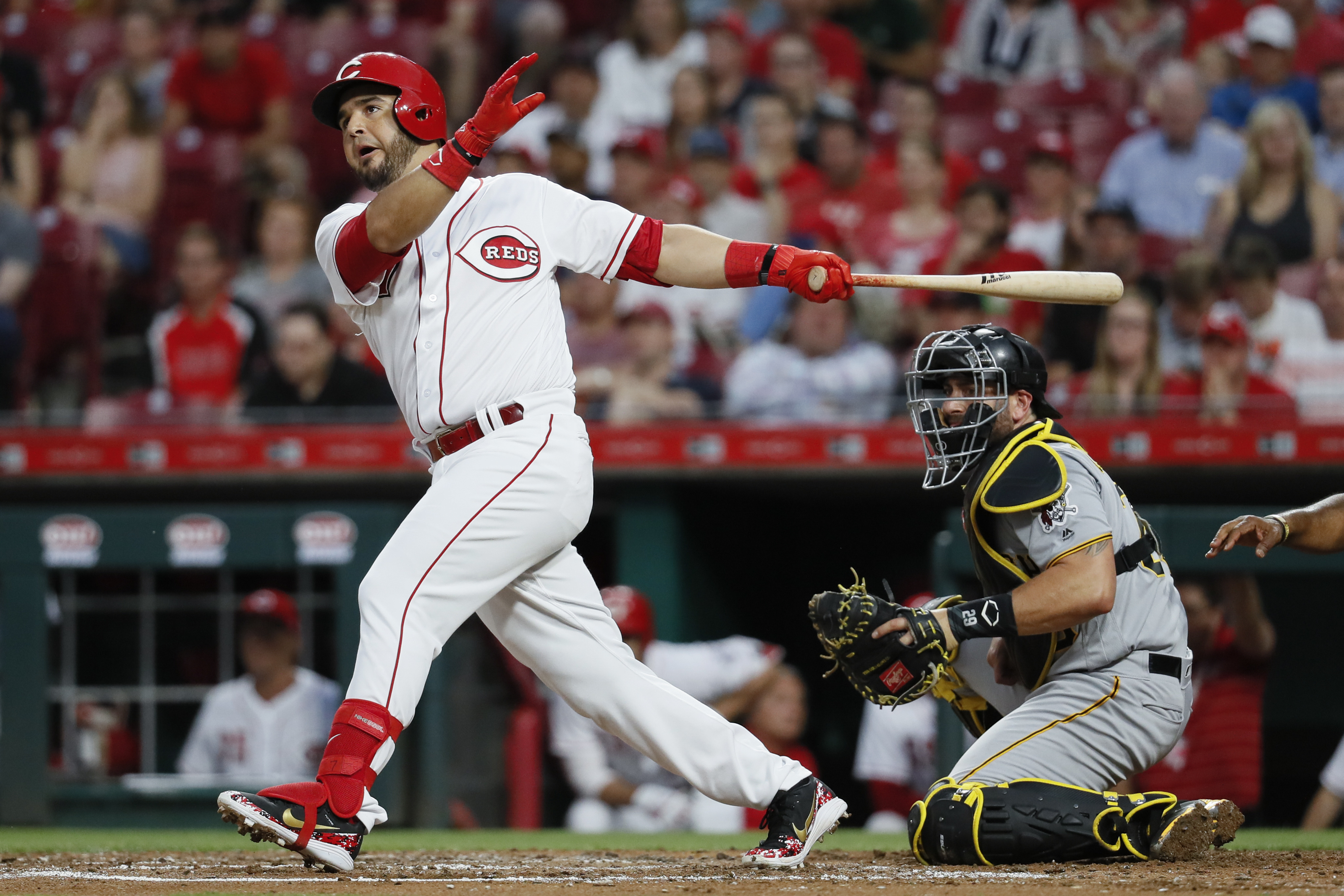 Cincinnati Reds' Eugenio Suarez watches his RBI double off Pittsburgh Pirates starting pitcher Jameson Taillon during the first inning of a baseball game, Tuesday, May 22, 2018, in Cincinnati. (AP Photo/John Minchillo)