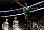 Milwaukee Bucks' Tony Snell (21) goes up for a dunk as Philadelphia 76ers' Richaun Holmes (22) and Dario Saric (9) trail during the first half of a game, Monday, March 6, 2017, in Philadelphia.