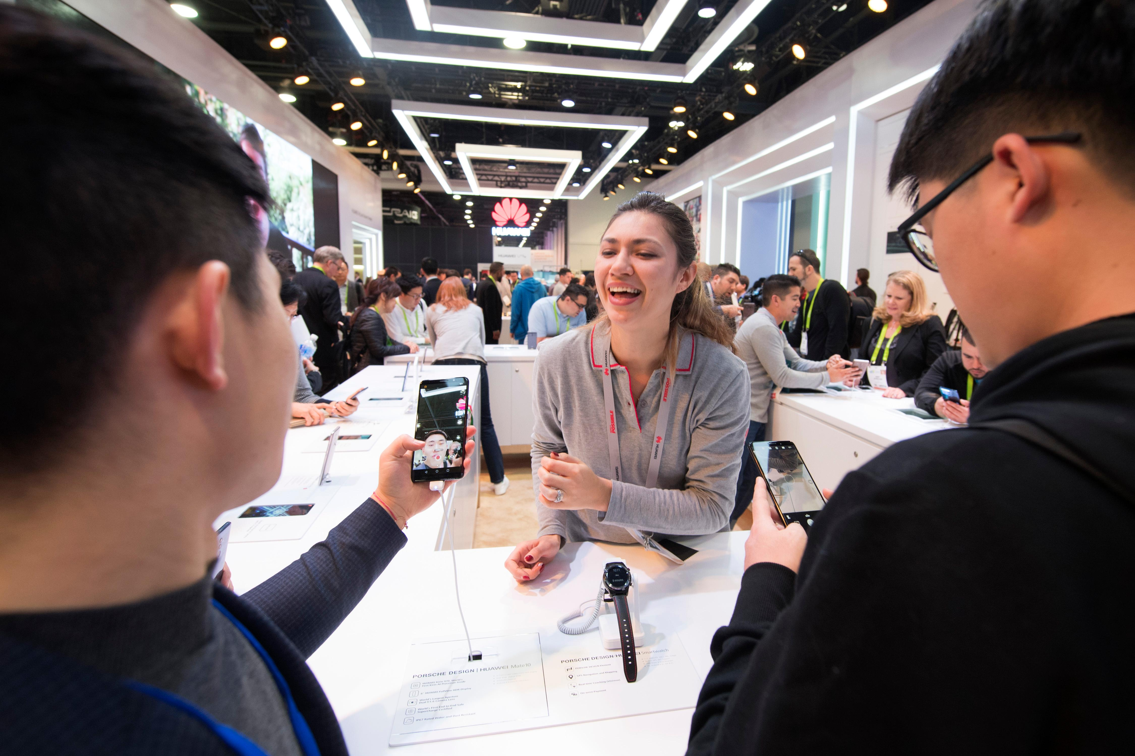 Mera Kolisnyk from Huawei demonstrates their phones during the second day of CES Wednesday, January 10, 2018, at the Las Vegas Convention Center. CREDIT: Sam Morris/Las Vegas News Bureau