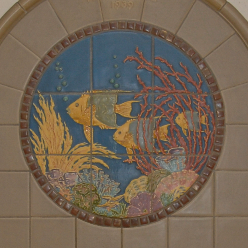 <p>Much like the tropical bird fountain, a fountain depicting three blue and yellow tropical fish was donated by the Art League of 1939. It's located on the third floor in the east (main) corridor. / Image and research by Tim Jeffries // Published: 4.28.19</p>