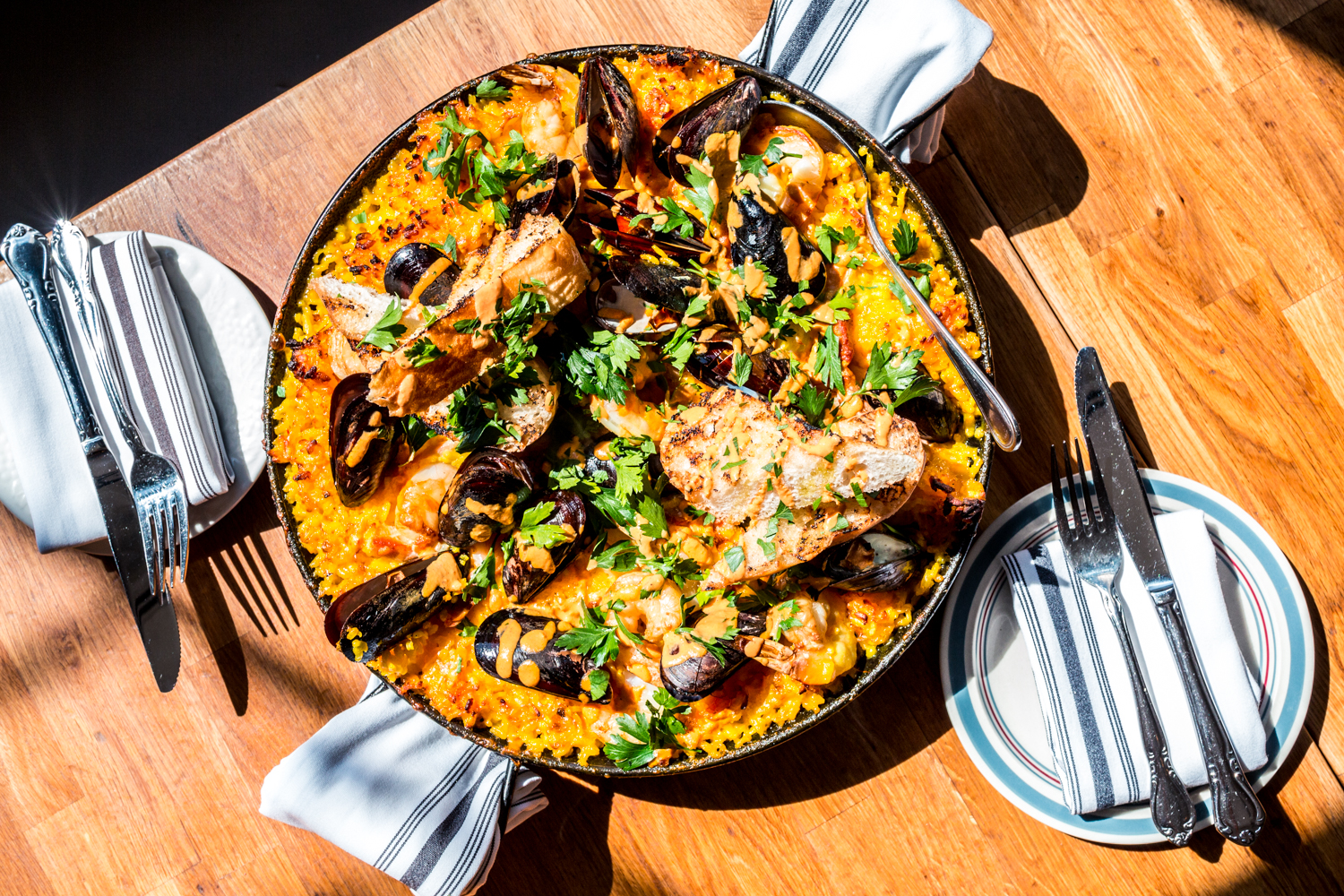 Paella (not on the menu daily): saffron risotto, halibut, shrimp, muscles, chorizo, and ham covered in a rouille / Image: Catherine Viox // Published: 9.30.19