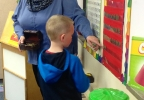 Golden Apple Award recipient Chris Skogg helps student Archer Kirkpatrick at Cormier Early Learning Center in Ashwaubenon.