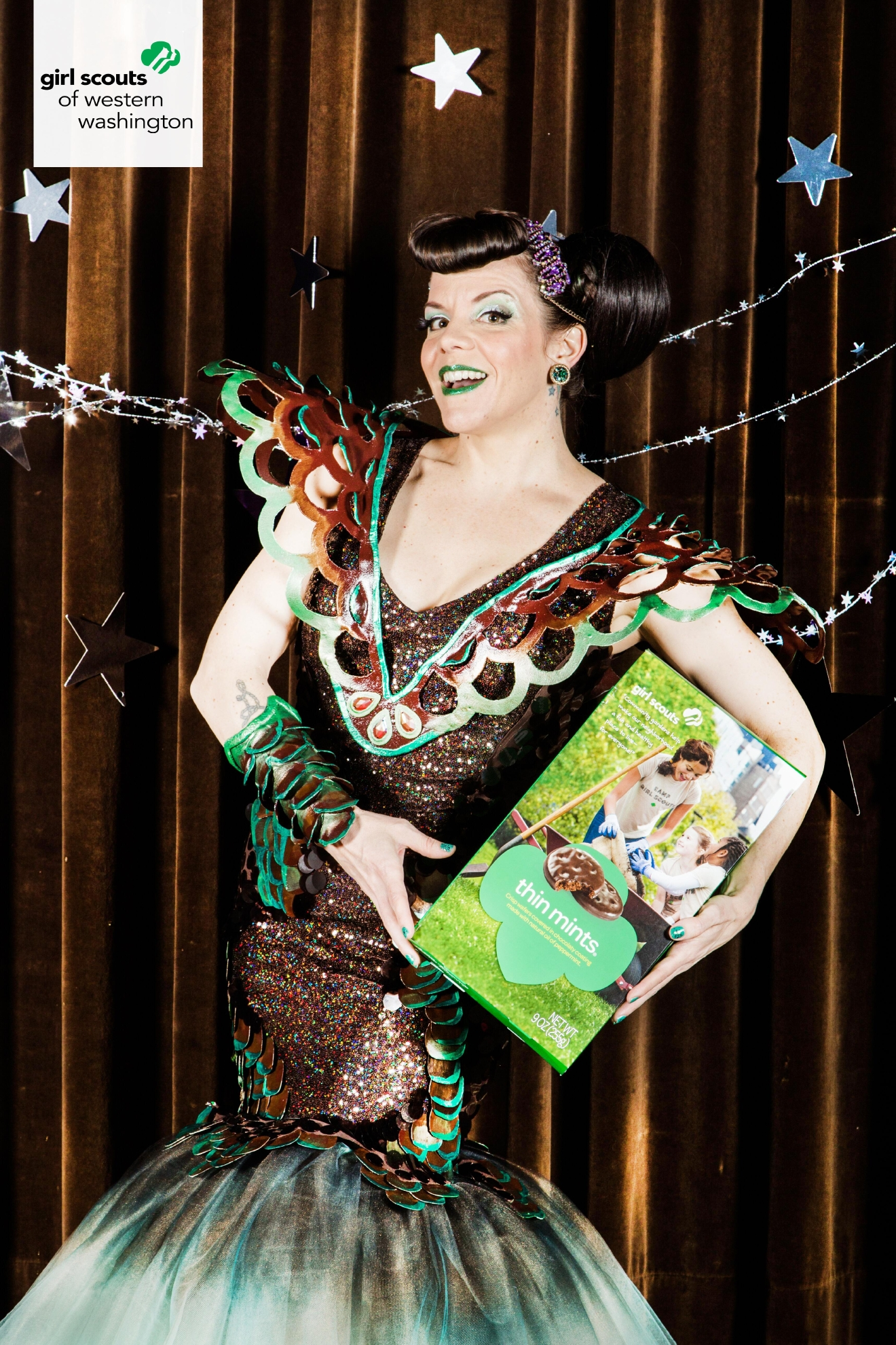 Designer Jamie Von Stratton is known for her wearable art and functional fashion but her Thin Mint Galaxy Goddess Gown might be her most amazing piece yet. Inspired by the multitude of STEM-related activities that the Girl Scouts are involved in, the Thin Mint Galaxy Goddess Gown has mermaid scales cut out of Thin Mint boxes and spray painted on one side. Photo Credit: David Jaewon Oh