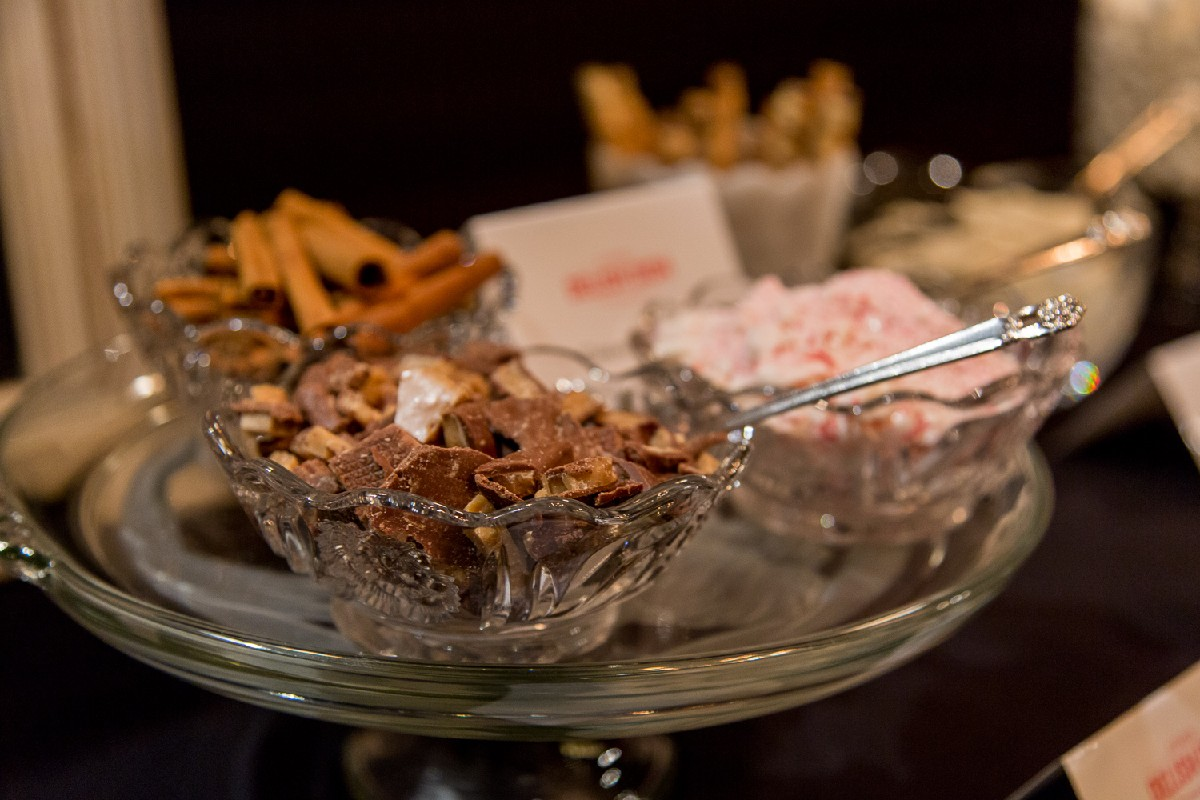 Heath bars, crushed peppermint, & fresh cinnamon sticks for the hot cocoa bar. (Image: Daniel Smyth Photography)