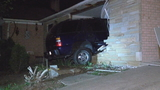 Woman buried under rubble after SUV with impaired driver crashes into house in PG County