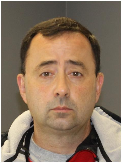 The plea was entered Tuesday by Larry Nassar of Holt, who was arraigned by video from jail. He was arrested Monday while running an errand. (Phone: Ingham County Sheriff's Office)
