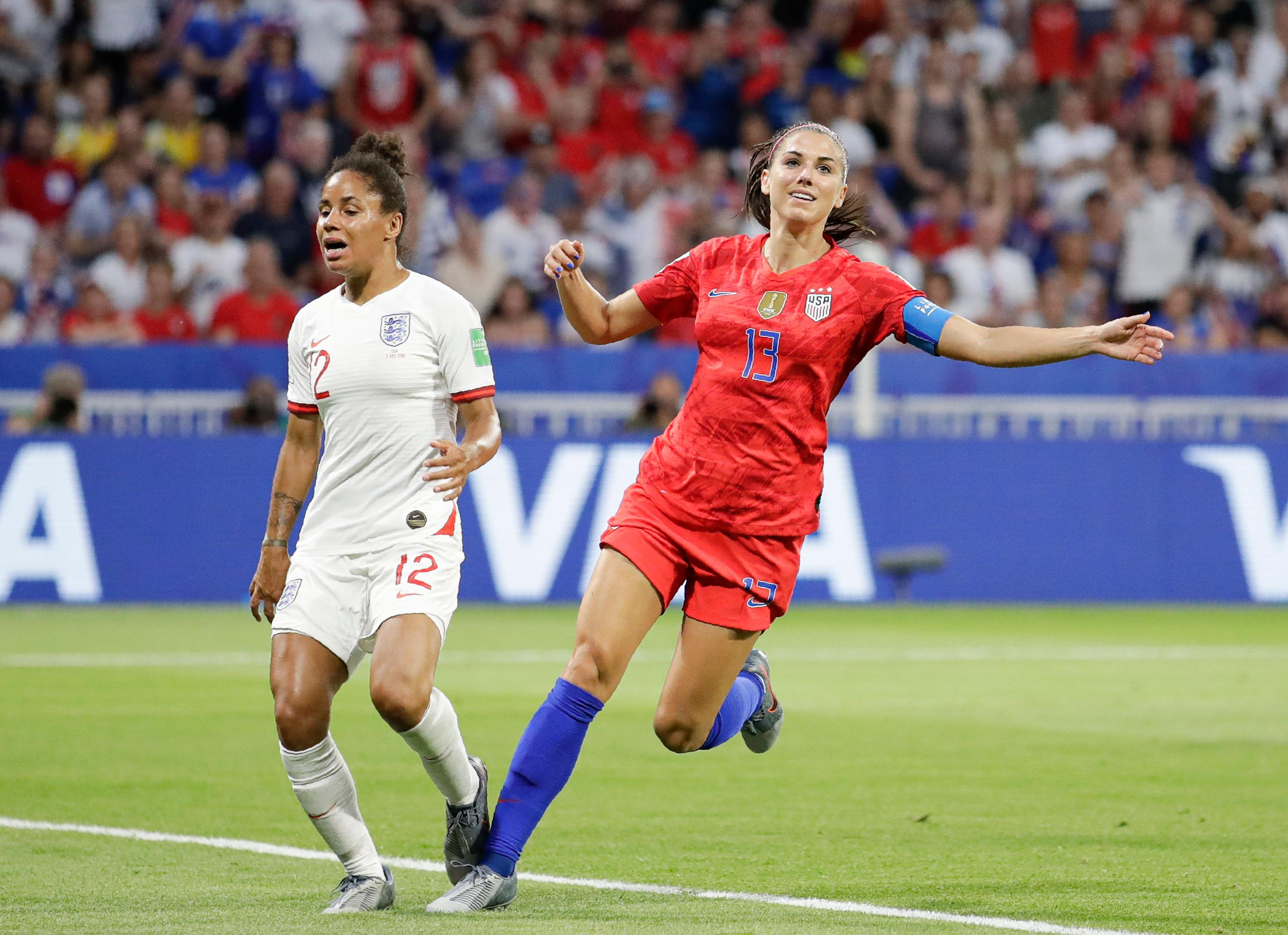 United States' Alex Morgan, right, celebrates after scoring her side's second goal next to England's Demi Stokes during the Women's World Cup semifinal soccer match between England and the United States, at the Stade de Lyon, outside Lyon, France, Tuesday, July 2, 2019. (AP Photo/Alessandra Tarantino)