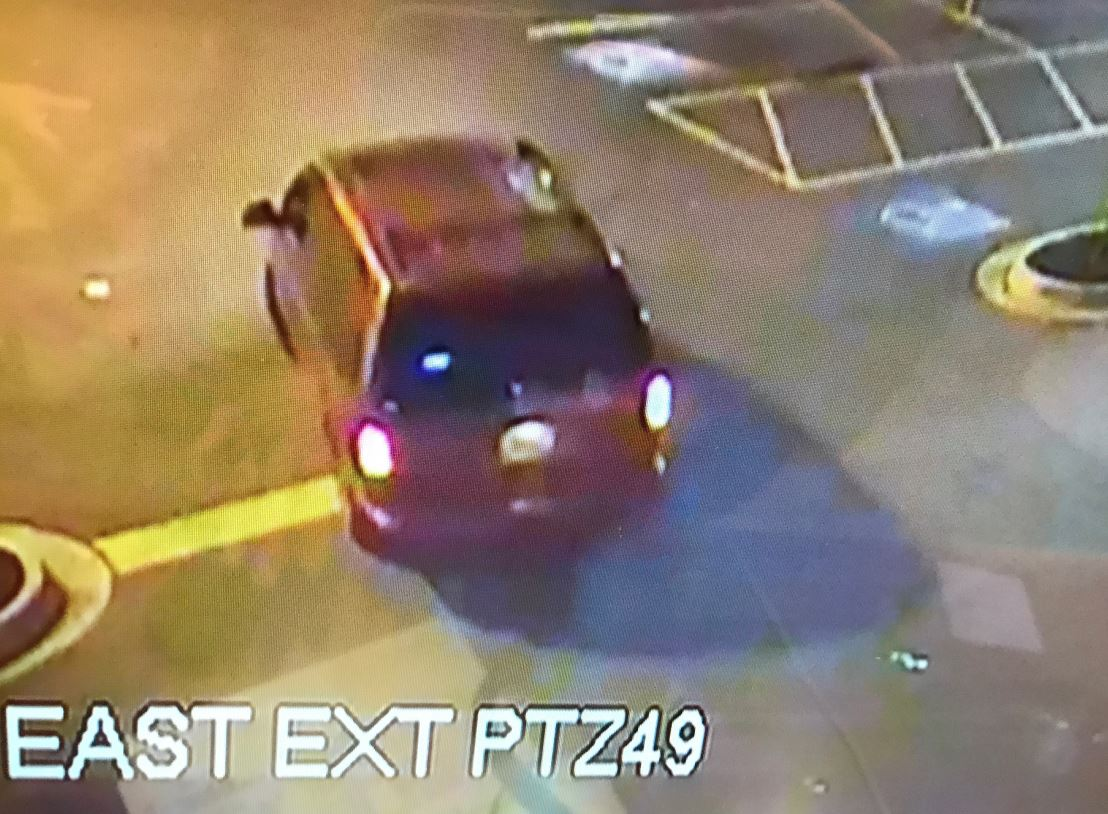 The vehicle is a red minivan possibly a Dodge Caravan or similar bearing an unknown Virginia license plate (Photo: LPD)