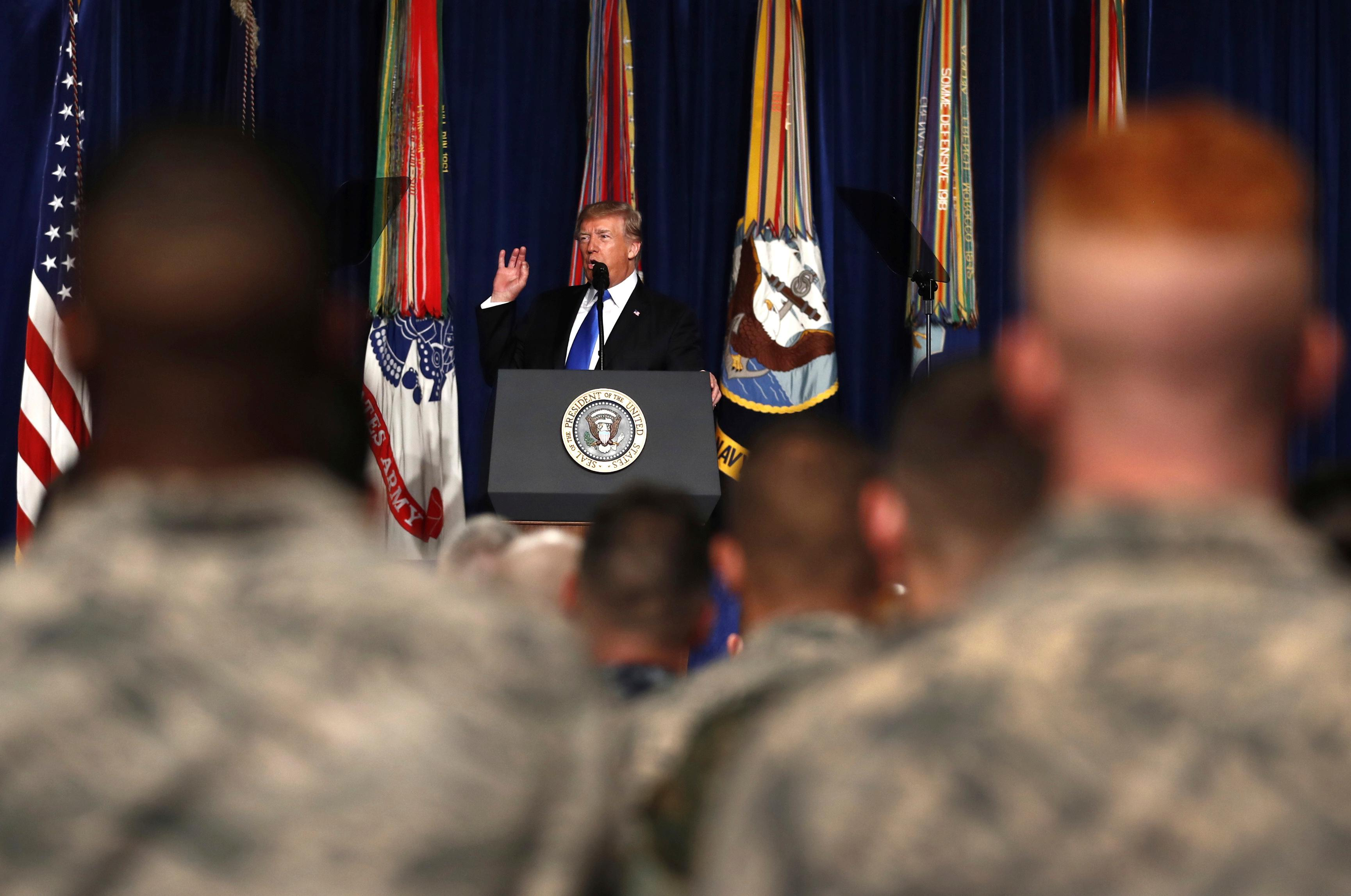 FILE - In this Aug. 21, 2017, file photo, President Donald Trump speaks at Fort Myer in Arlington Va., about U.S. strategy in Afghanistan. Trump on Oct. 17 will call the families of four soldiers killed this month in Niger, the White House says, as Trump again casts doubt on whether his predecessor appropriately consoled the families of military personnel who died in war. (AP Photo/Carolyn Kaster, File)