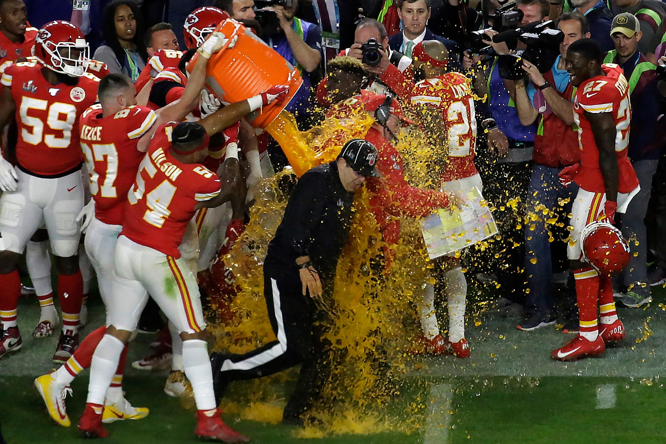 Kansan City Chiefs' players pour a cooler of Gatorade on head coach Andy Reid and members of the coaching staff, after winning the NFL Super Bowl 54 football game Sunday, Feb. 2, 2020, in Miami Gardens, Fla.{ } (AP Photo/Brynn Anderson)