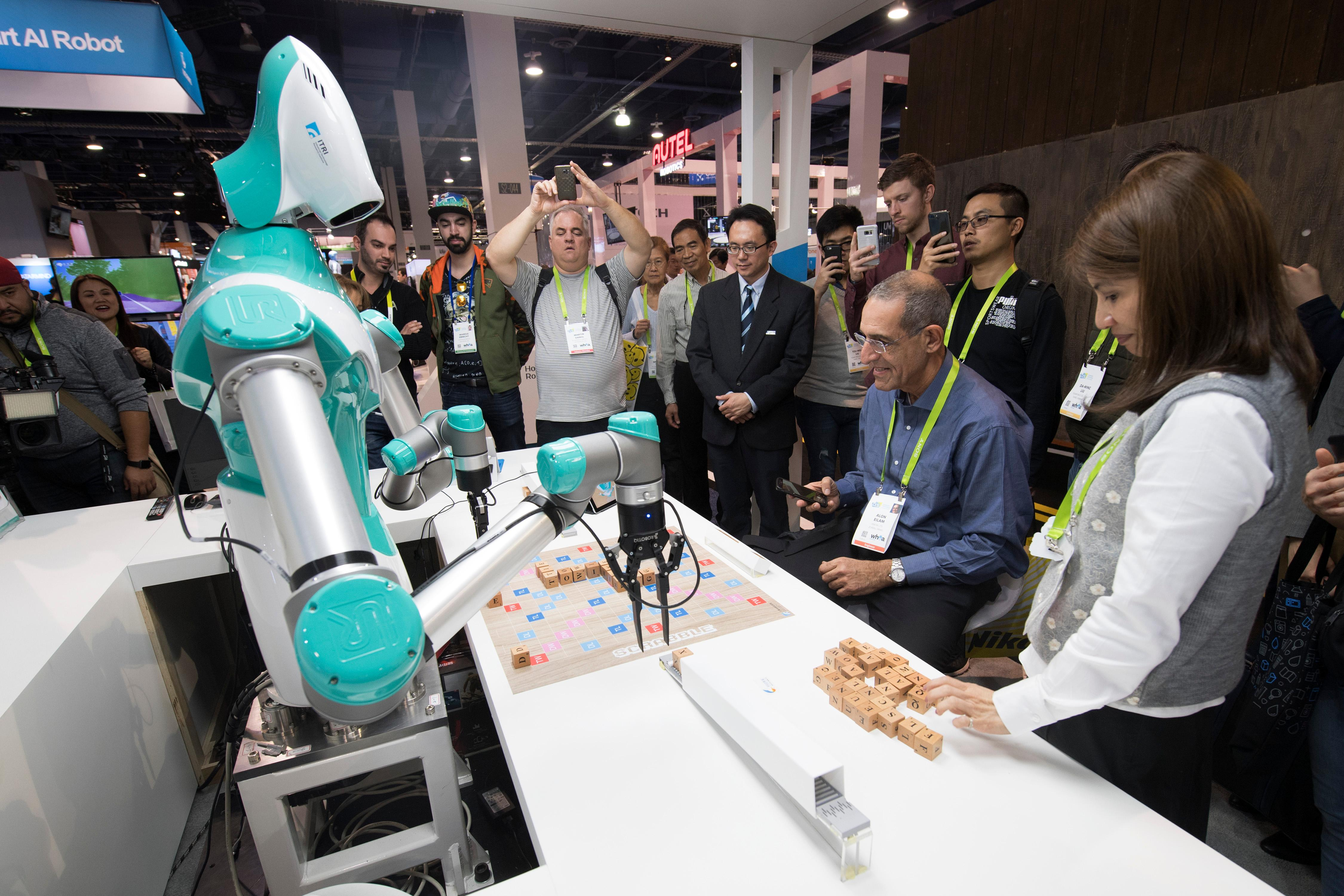Elon Eilam plays Scrabble against a robot from Industrial Technology Research Institute during the second day of CES Wednesday, January 10, 2018, at the Las Vegas Convention Center. CREDIT: Sam Morris/Las Vegas News Bureau