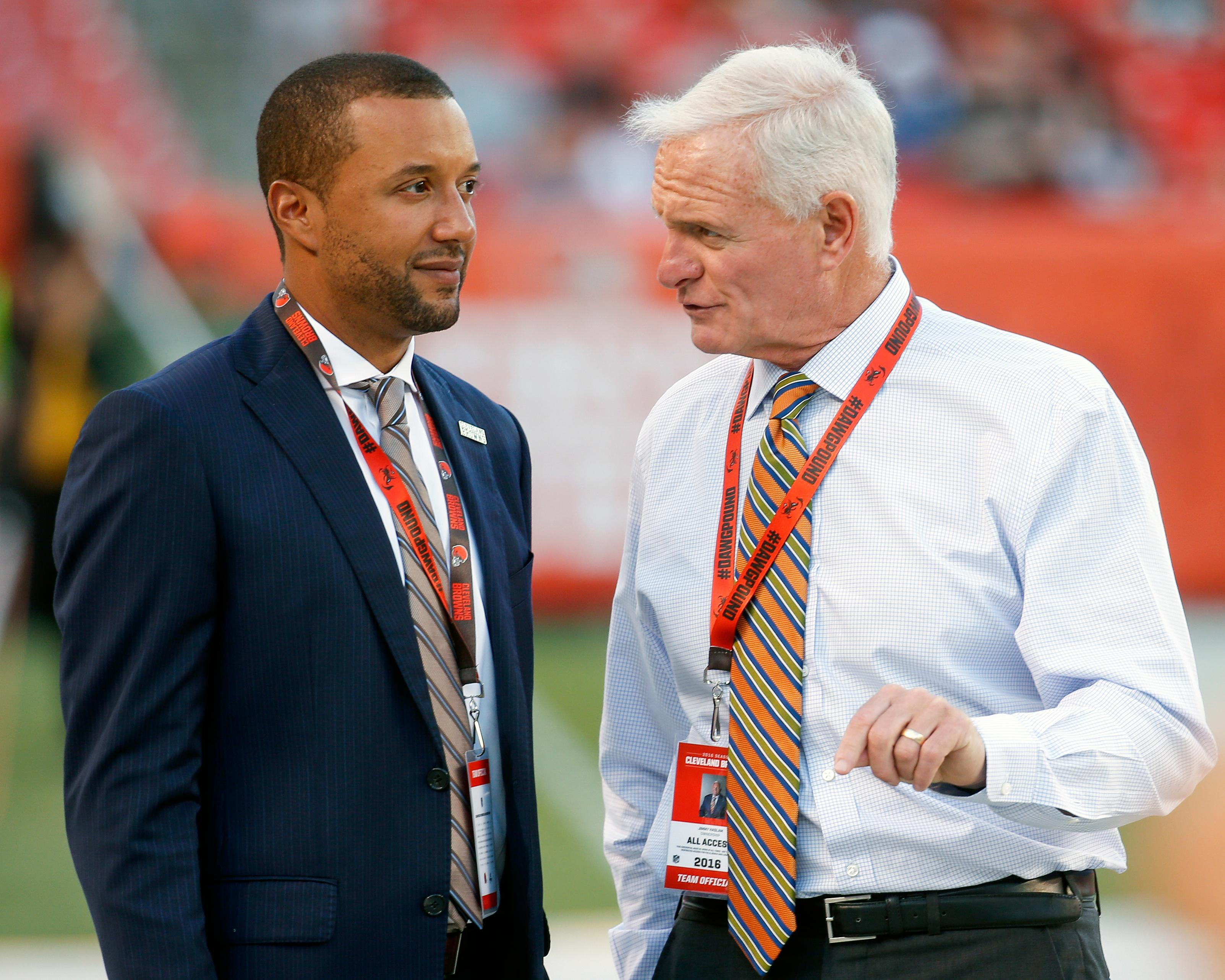 FILE - In this Aug. 18, 2016, file photo, Sashi Brown, acting executive vice president of football operations for the Cleveland Browns, left, speaks with Browns' owner Jimmy Haslam during practice before an NFL preseason football game against the Atlanta Falcons, in Cleveland. A person familiar with the decisions says the Cleveland Browns have fired Sashi Brown, the club's vice president of football operations. Brown, who was named the team's top executive by owners Dee and Jimmy Haslam during an overhaul following the 2015 season, was relieved of his duties on Thursday, Dec. 7, 2017, said the person who spoke to the Associated Press on condition of anonymity because the team has not announced the move. (AP Photo/Ron Schwane)