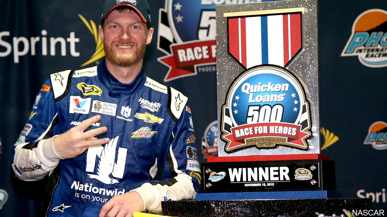 (FILE) Dale Earnhardt Jr. celebrates in victory lane after winning the rain-shortened NASCAR Sprint Cup Series Quicken Loans Race for Heroes 500 in 2015, Photo Date: 2015 (Photo credit: NASCAR)
