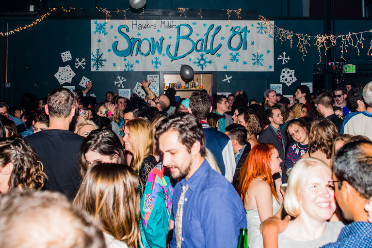 "When we saw a Facebook event called ""The Hawkins Snow Ball - A Stranger Things Dance Night"" pop up on our news feed...we knew we HAD to be there! Neumos on Capitol Hill in Seattle, WA hosted this sold out event on Friday, January 5, 2017 and it was a hoot and a half! Fans of the Netflix series came dressed to impress at the 80s-themed prom, complete with a photo booth, balloons, classic prom tunes, a disco ball and more! Click on to revel in the glory, and put this on your radar for the next event! (Image: Chona Kasinger / Seattle Refined)"