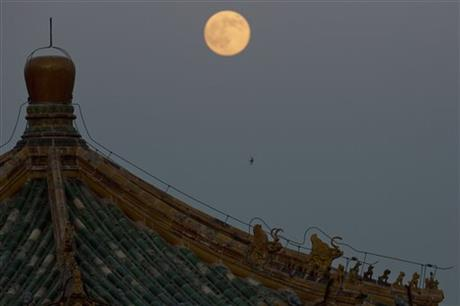 A perigee moon also known as a supermoon rises above a Chinese pavilion in Beijing, China, Saturday, July 12, 2014.