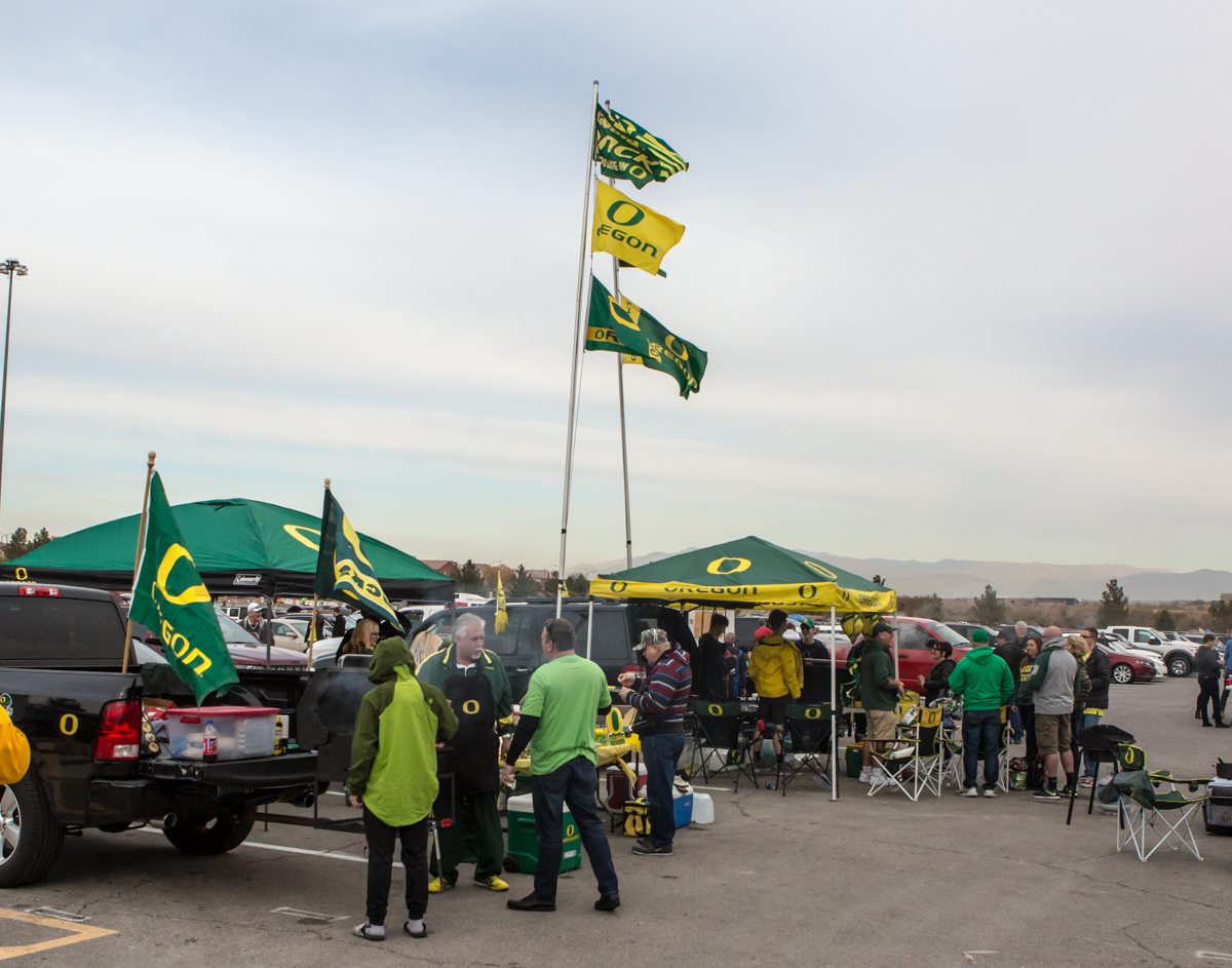 Oregon fans tailgate before the game at Sam Boyd Stadium. The Boise State Broncos defeated the Oregon Ducks 38 to 28 in the 2017 Las Vegas Bowl at Sam Boyd Stadium in Las Vegas, Nevada on Saturday December 17, 2017. The Las Vegas Bowl served as the first test for Oregon's new Head Coach Mario Cristobal following the loss of former Head Coach Willie Taggart to Florida State University earlier this month. Photo by Ben Lonergan, Oregon News Lab