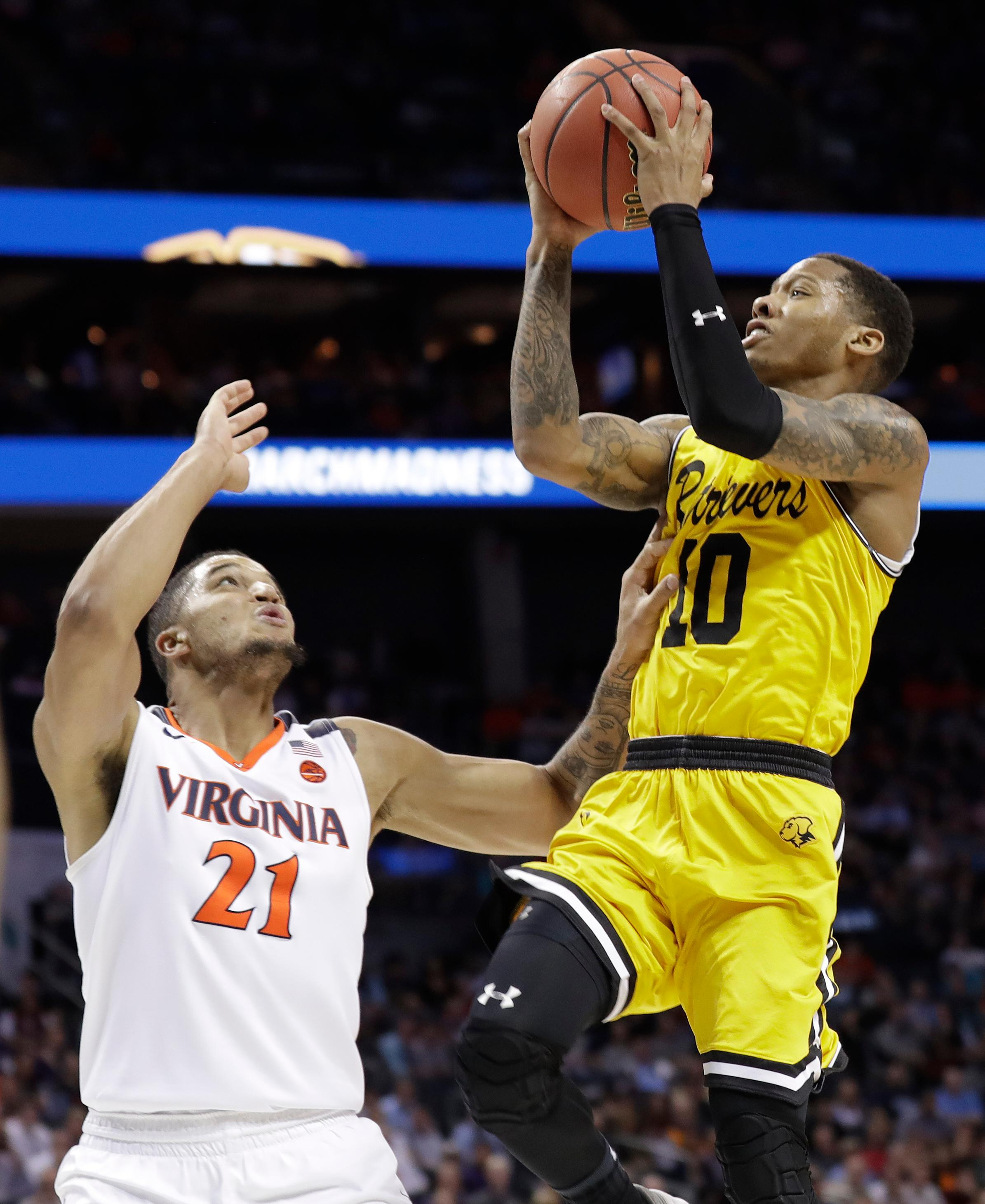 UMBC's Jairus Lyles (10) shoots over Virginia's Isaiah Wilkins (21) during the second half of a first-round game in the NCAA men's college basketball tournament in Charlotte, N.C., Friday, March 16, 2018. (AP Photo/Gerry Broome)