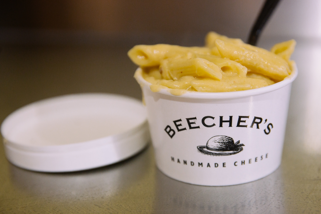 "Beecher's Cheese is a must stop for anyone visiting Pike Place Market. Their ""World Famous Mac and Cheese"" is perfect at 8oz and runs just $6 dollars. (Image: Joshua Lewis / Seattle Refined)"