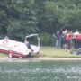 Body pulled from Windjammer Apartments pond after 11 hours of searching