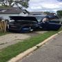 Driver swerves to miss cat, crashes into pole, damaging boat trailer and house