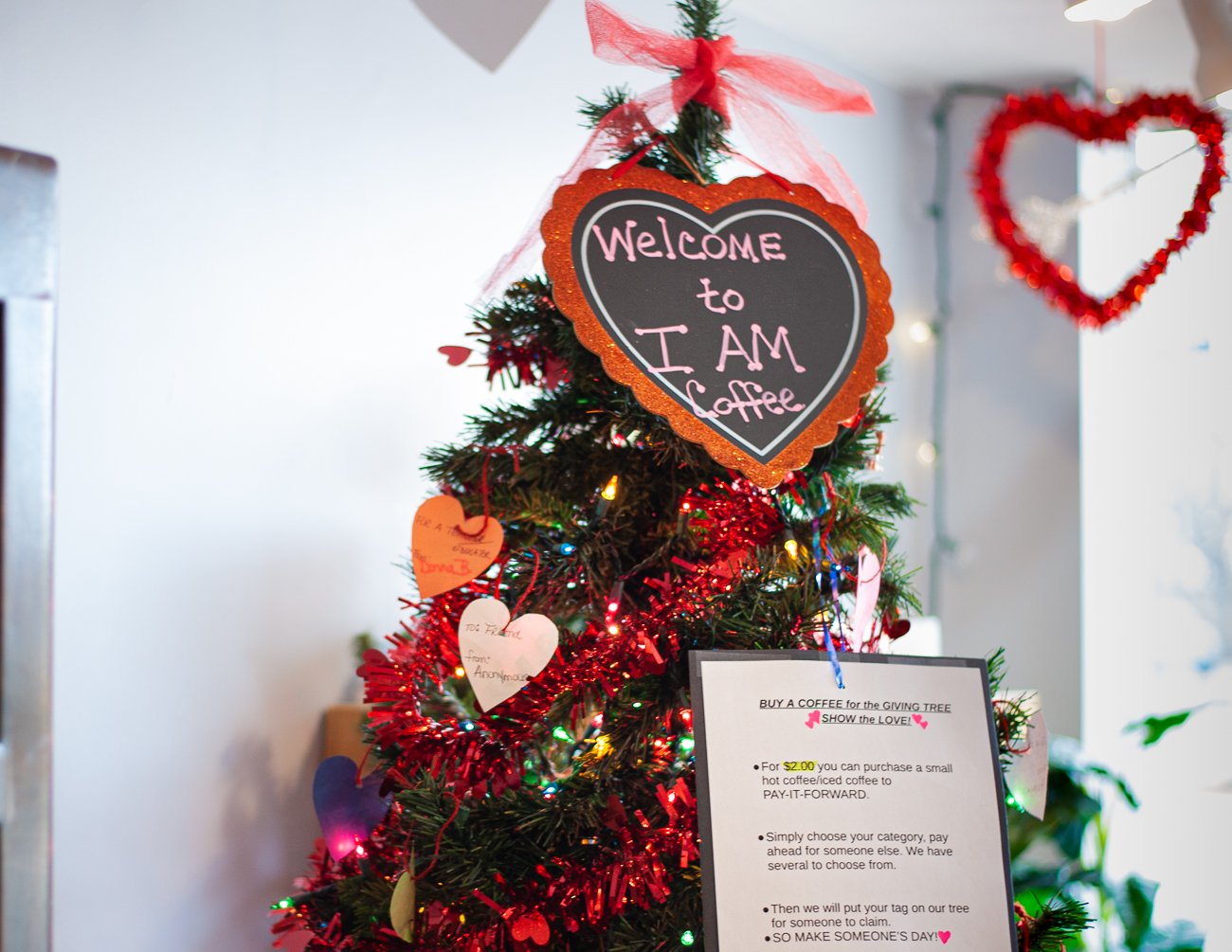 The Give Back Tree gives customers the chance to purchase a small coffee, fill out a tag, and add the tag to the tree, dedicating a free cup of coffee to whoever they label it with.  / Image: Kellie Coleman // Published: 1.31.21