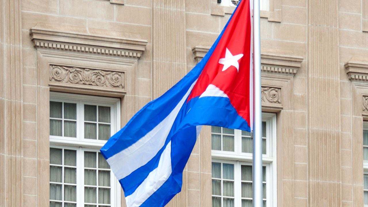 PHOTO: Cuban flag raised outside of the embassy in Washington, DC., Photo Date: July 2015{ }Cropped Photo: Alejandro Alvarez / CC BY-SA 4.0 via MGN