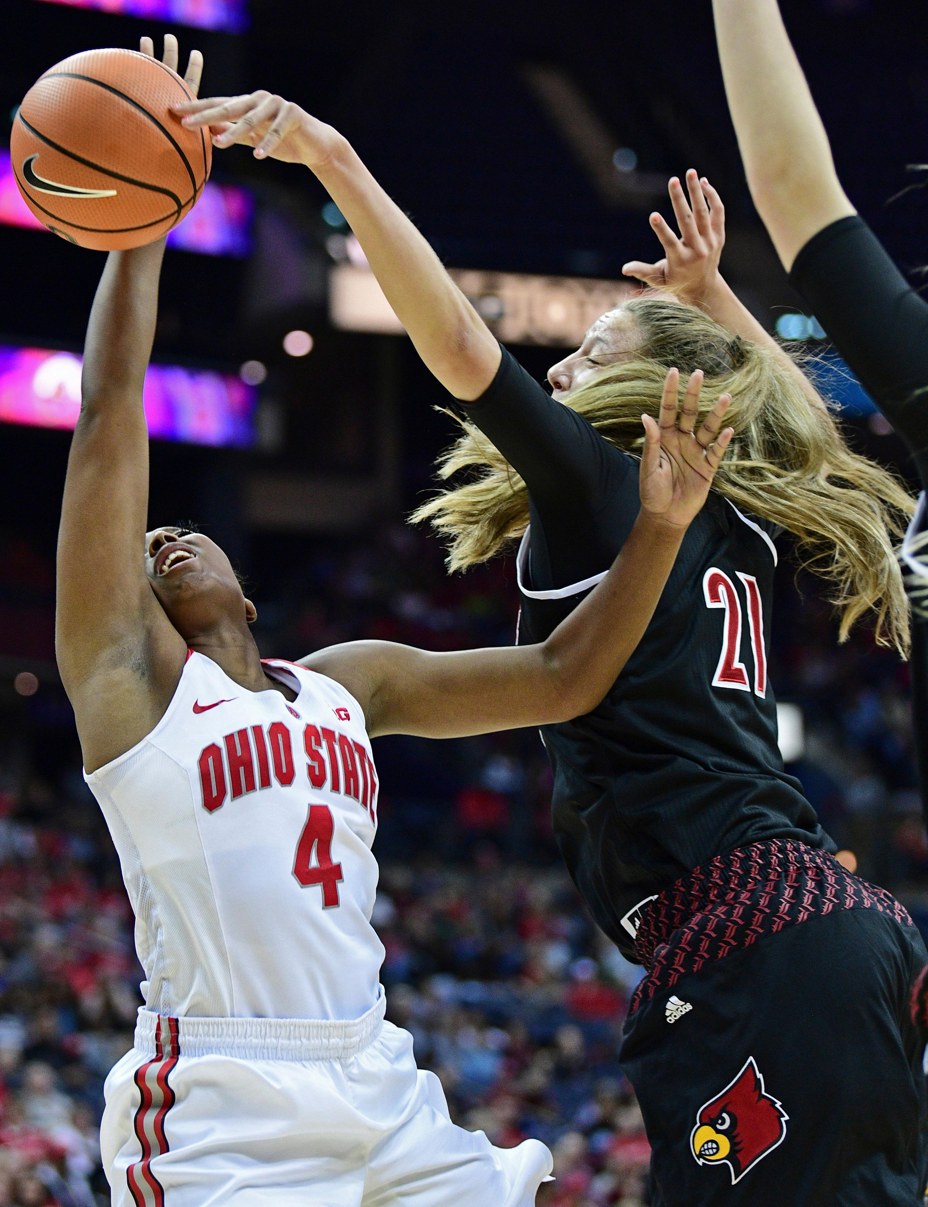 Louisville's Kylee Shook (21) blocks the shot of Ohio State's Sierra Calhoun during the second quarter of an NCAA college basketball game, Sunday, Nov. 12, 2017, in Columbus, Ohio. (AP Photo/David Dermer)