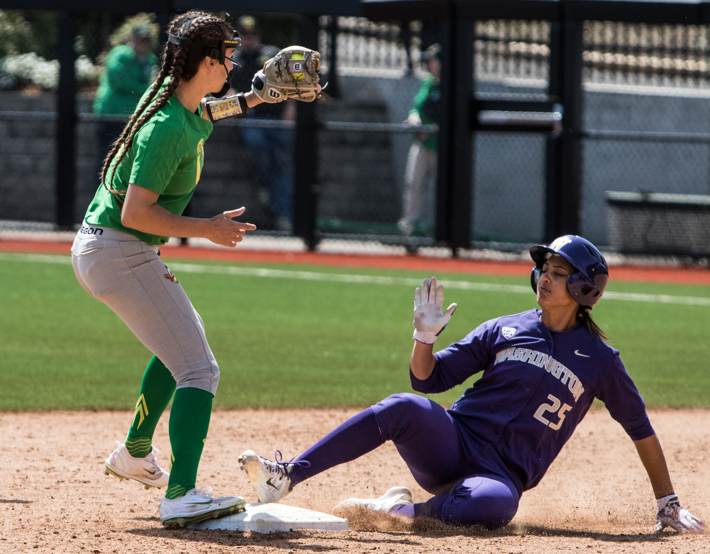 Oregon Ducks infielder Nikki Udria (#3) forces Washington Husky Kirstyn Thomas (#25) out at second base. In the final game of a three-game series, the University of Washington Huskies defeated the Oregon Ducks 5-3.  The Ducks led through the bottom of the 7th inning, but Washington's Morganne Flores (#47) tied it up with a two-run double.  Flores drove in two more runs in the 9th to take the lead.  Photo by Austin Hicks, Oregon News Lab