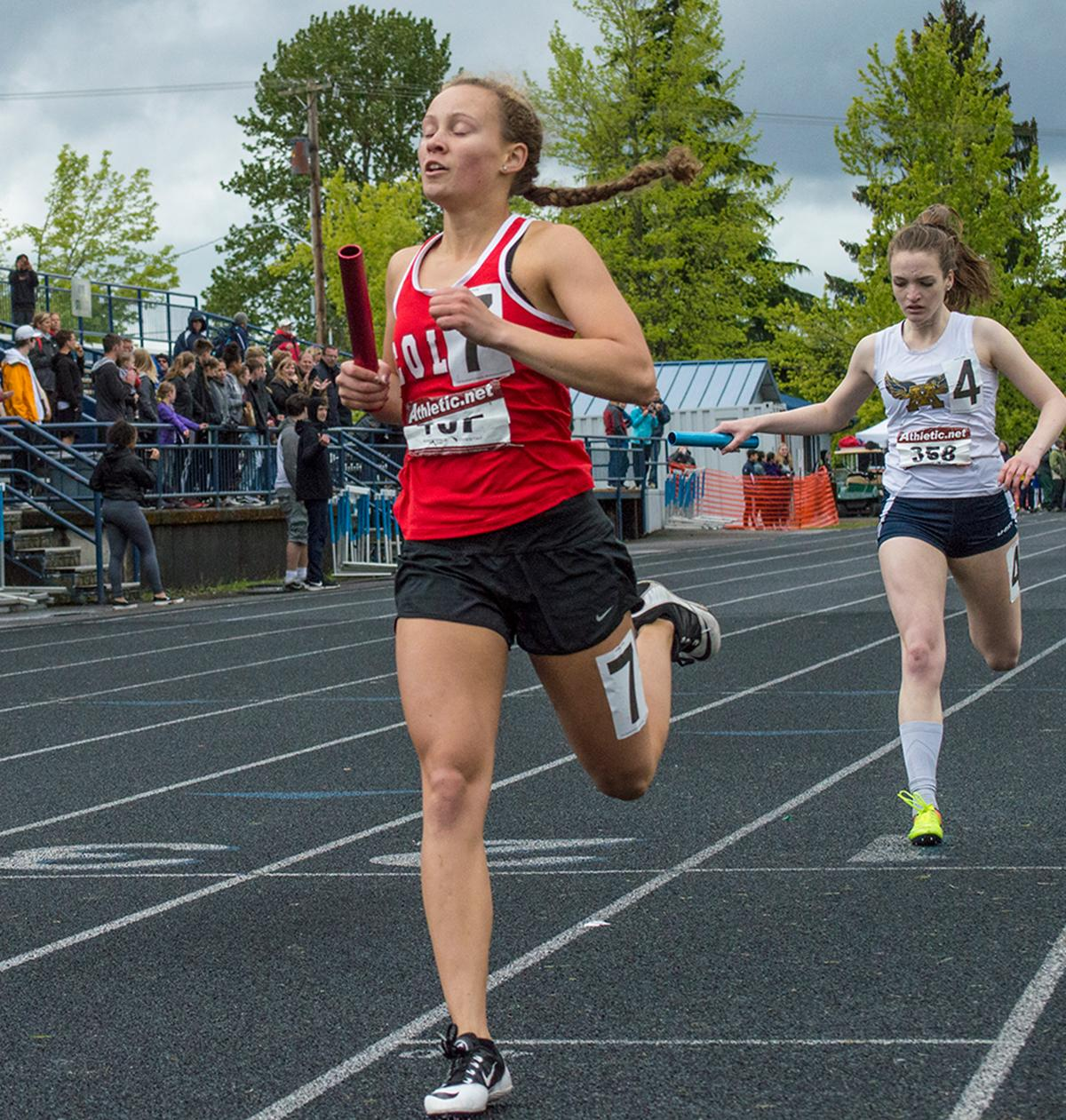 Anchor Tara Crosswhite crosses the finish line. The Colts take first in the Women's 4 x 400m event at the 5A-3 Midwestern League District Championship with a time of 4:10.75. Photo by Emily Gonzalez, Oregon News Lab.