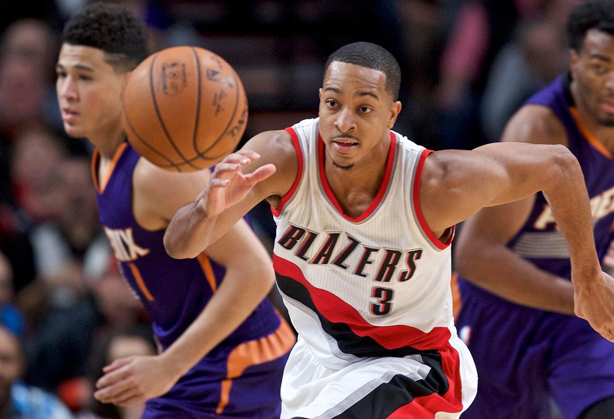 Portland Trail Blazers guard C.J. McCollum chases a loose ball during the first half of the team's NBA basketball game against the Phoenix Suns in Portland, Ore., Tuesday, Nov. 8, 2016. (AP Photo/Craig Mitchelldyer)