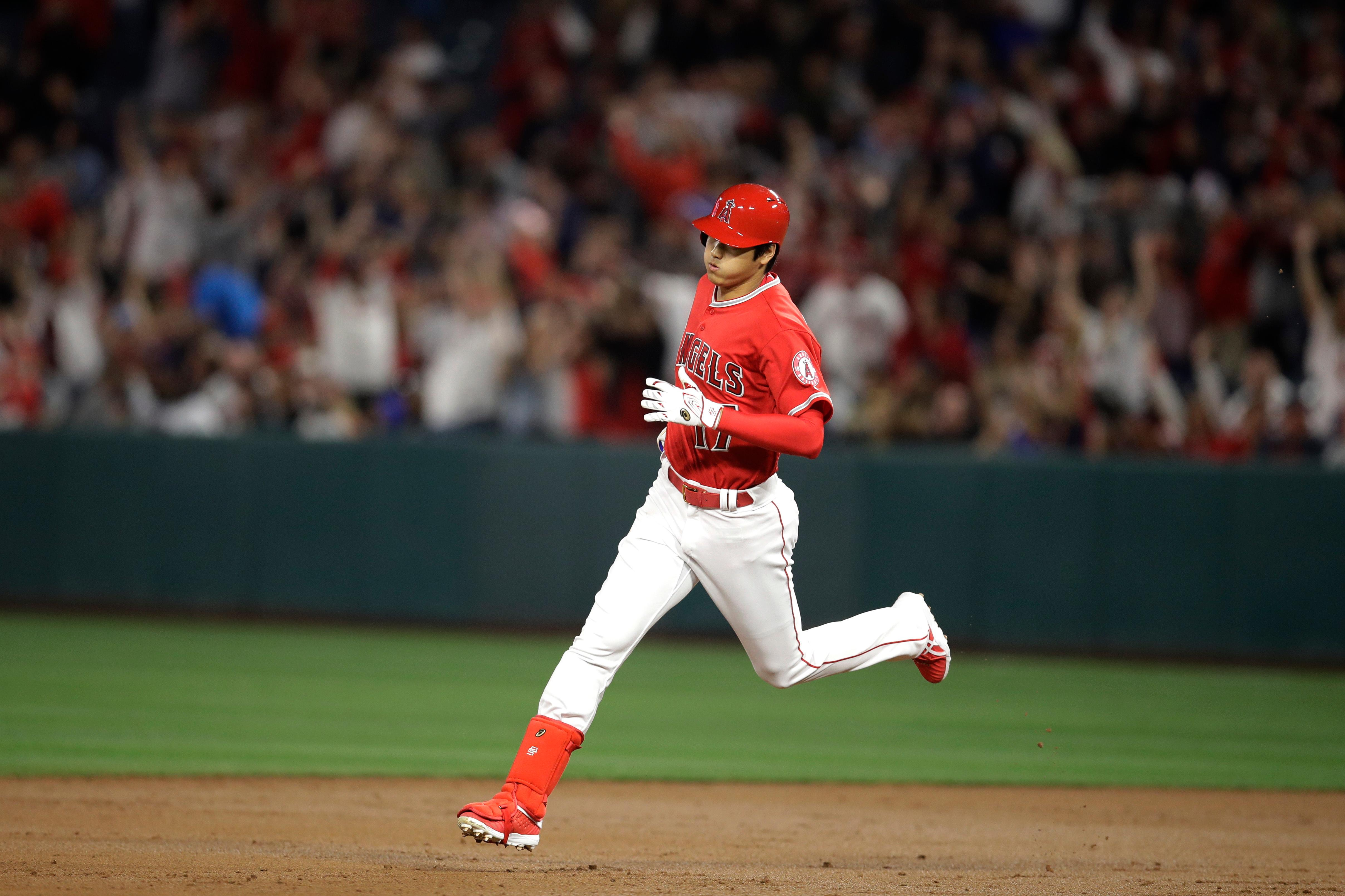 Los Angeles Angels starting pitcher Shohei Ohtani, of Japan, rounds the bases after hitting a three-run home run during the first inning of a baseball game against the Cleveland Indians Tuesday, April 3, 2018, in Anaheim, Calif. (AP Photo/Jae C. Hong)
