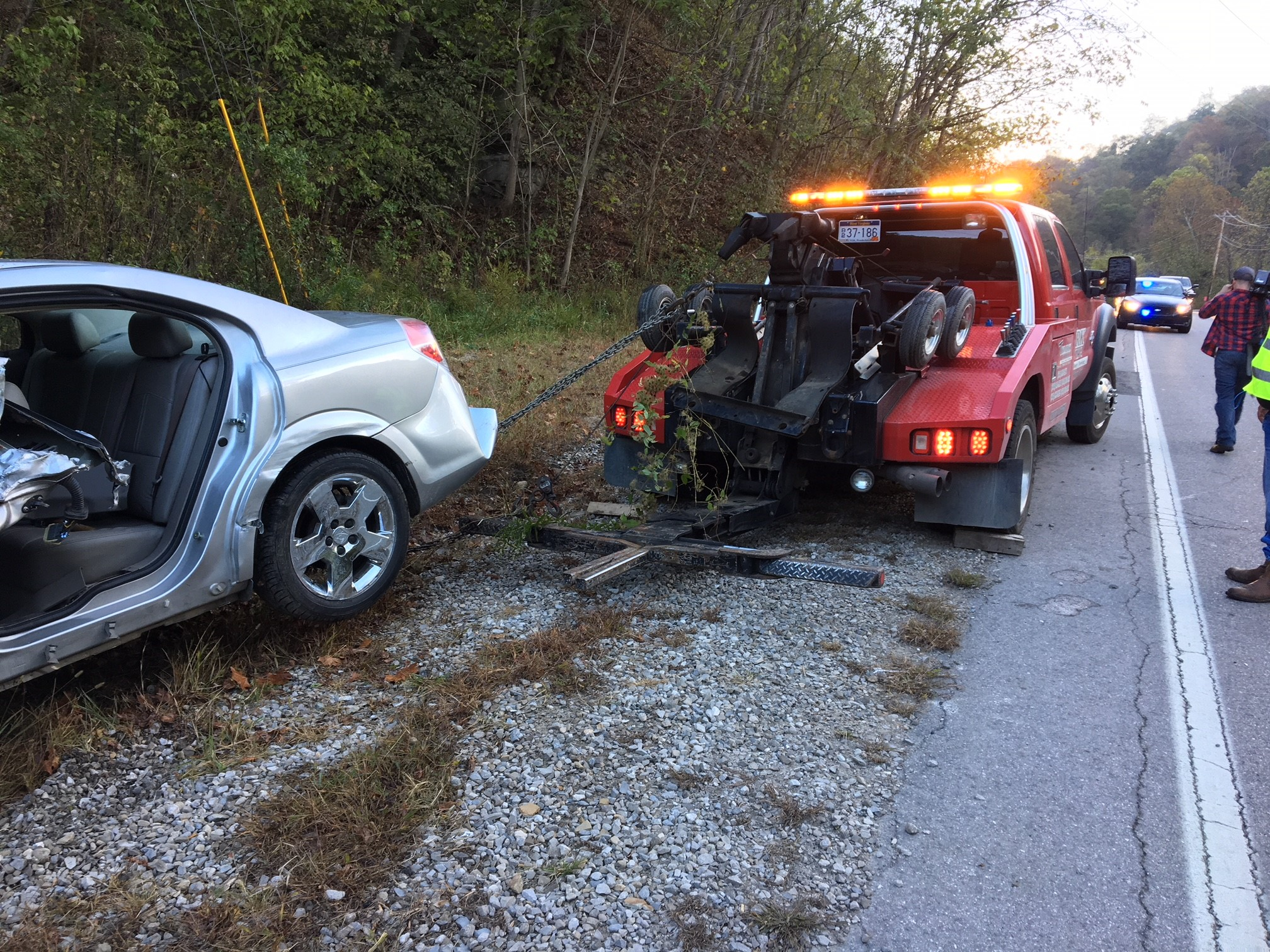 The Saturn crossed the center line of the road when a truck swerved to miss and clipped its trailer, striking a guard ail. (WCHS/WVAH)<p></p>