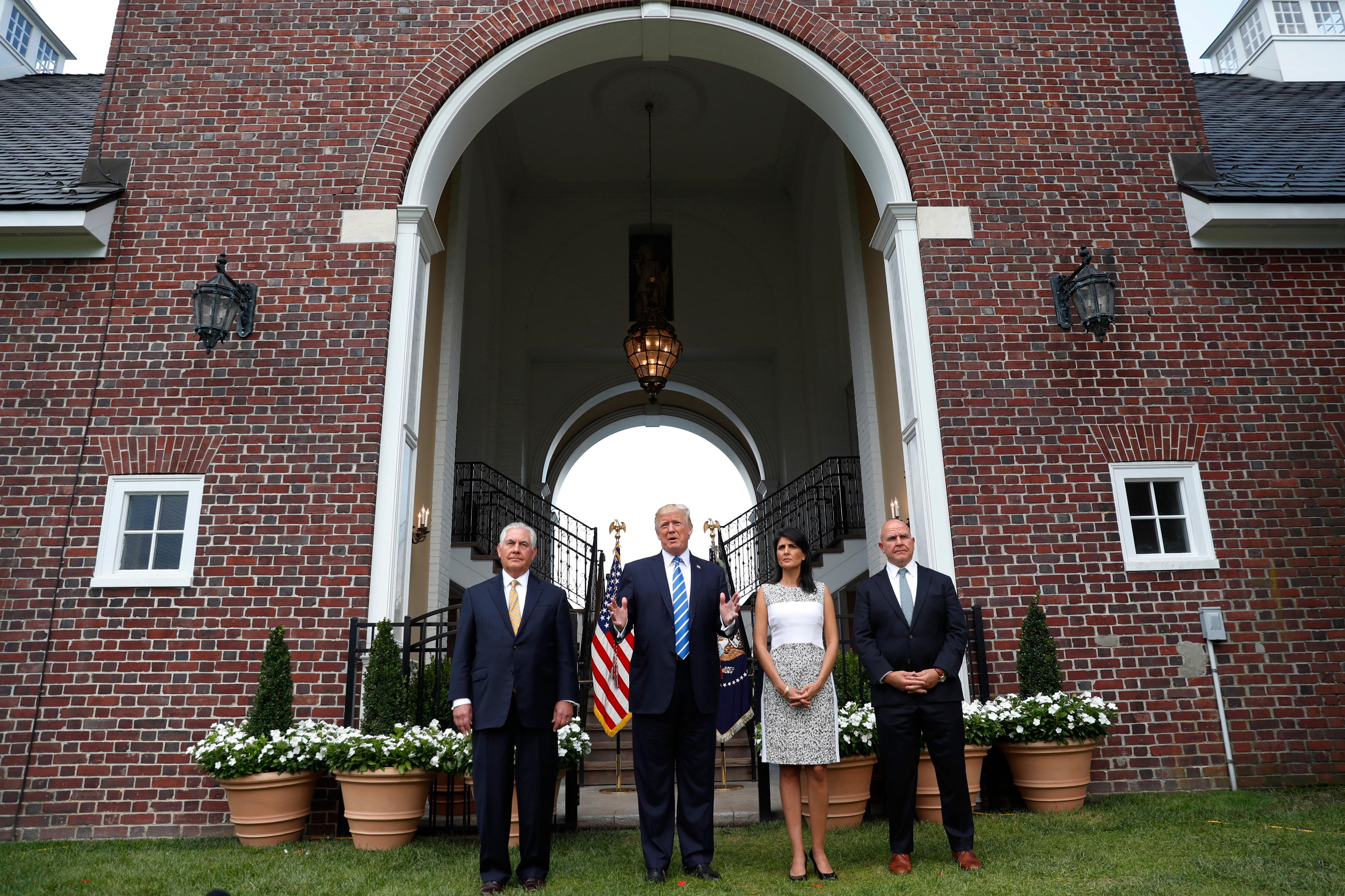 President Donald Trump speaks as Secretary of State Rex Tillerson, U.S. Ambassador to the United Nations Nikki Haley and national security adviser H.R. McMaster listen at Trump National Golf Club in Bedminster, N.J., Friday, Aug. 11, 2017. (AP Photo/Pablo Martinez Monsivais)