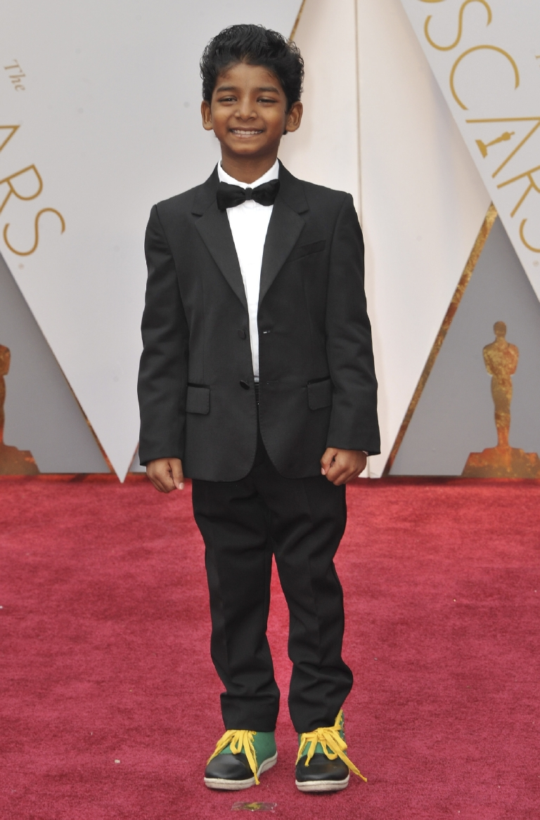 No one can hold a candle to Sunny Pawar in the cute department, but he really stole the show with these green and black sneakers with yellow laces. (Image: Apega/WENN.com)