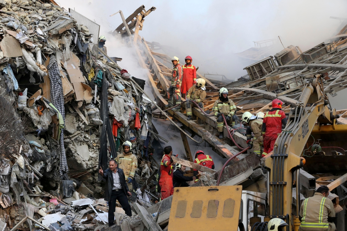 Firefighters work during the operations removing debris of the Plasco building where collapsed after engulfed by a fire, in central Tehran, Iran, Thursday, Jan. 19, 2017. The disaster struck the Plasco building, an iconic structure in central Tehran just north of the Iranian capital's sprawling bazaar. Firefighters, soldiers and other emergency responders dug through the rubble, looking for survivors. (AP Photo/Vahid Salemi)