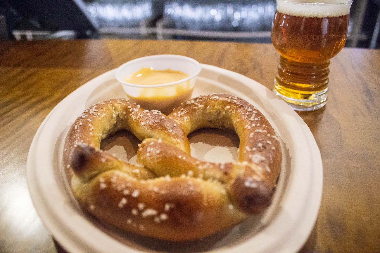 If you want a snack with your brew, Comets Pizza next door created a menu specially-made for Common Beer Co. You can place your order at the bar and the food is brought to you. On Sundays, a food truck caters to patrons. / Image: Katie Robinson, Cincinnati Refined // Published: 1.4.19